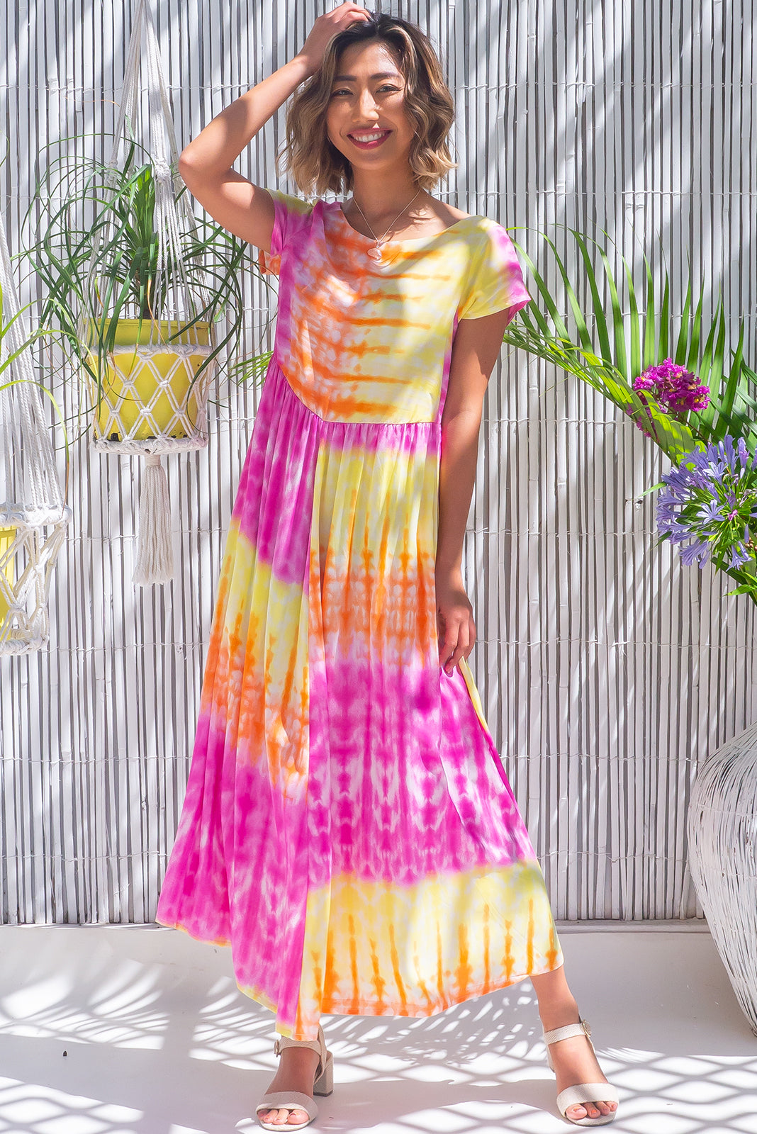 The Cocoloco Gelati Tie Dye Midi Dress is such a pretty tie day dress featuring relaxed fit, short sleeves, side pockets and 100% rayon in hot pink, yellow and orange tie dye print.