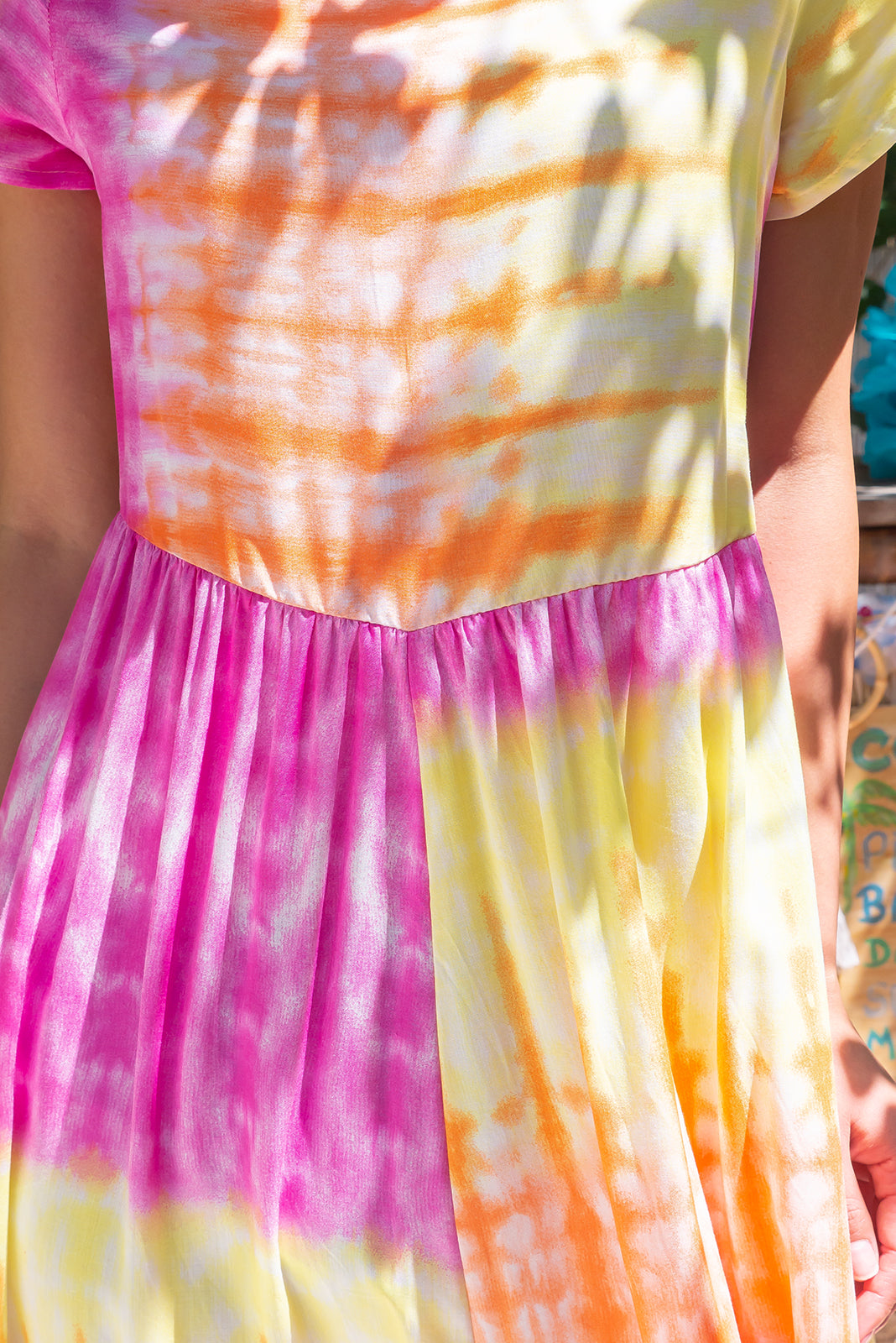 Fabric Swatch of  Cocoloco Gelati Tie Dye Midi Dress featuring 100% rayon in hot pink, yellow and orange tie dye print.