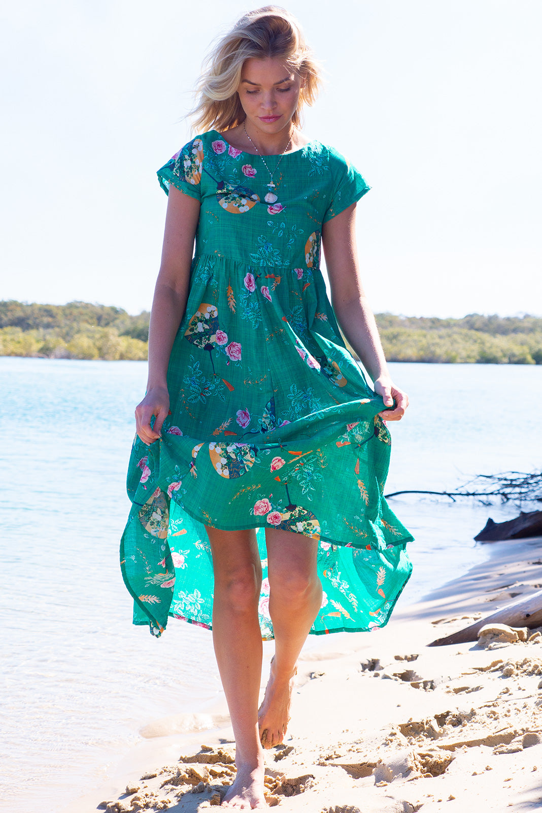 The Cocoloco Green Tea Dress is a retro frock featuring short sleeves, side pockets and 100% cotton in bright vibrant green base with oriental fan print.