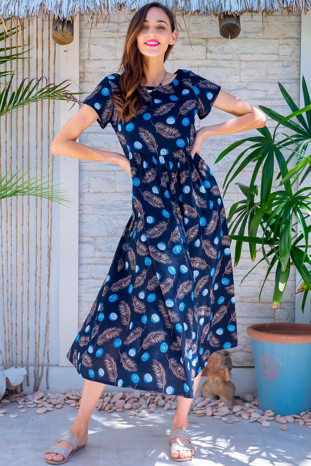 Easy and breezy day dress, the Cocoloco Midnight Coconuts Midi Dress has short sleeves, side pockets and 100% cotton in ink base with blue coconut print.