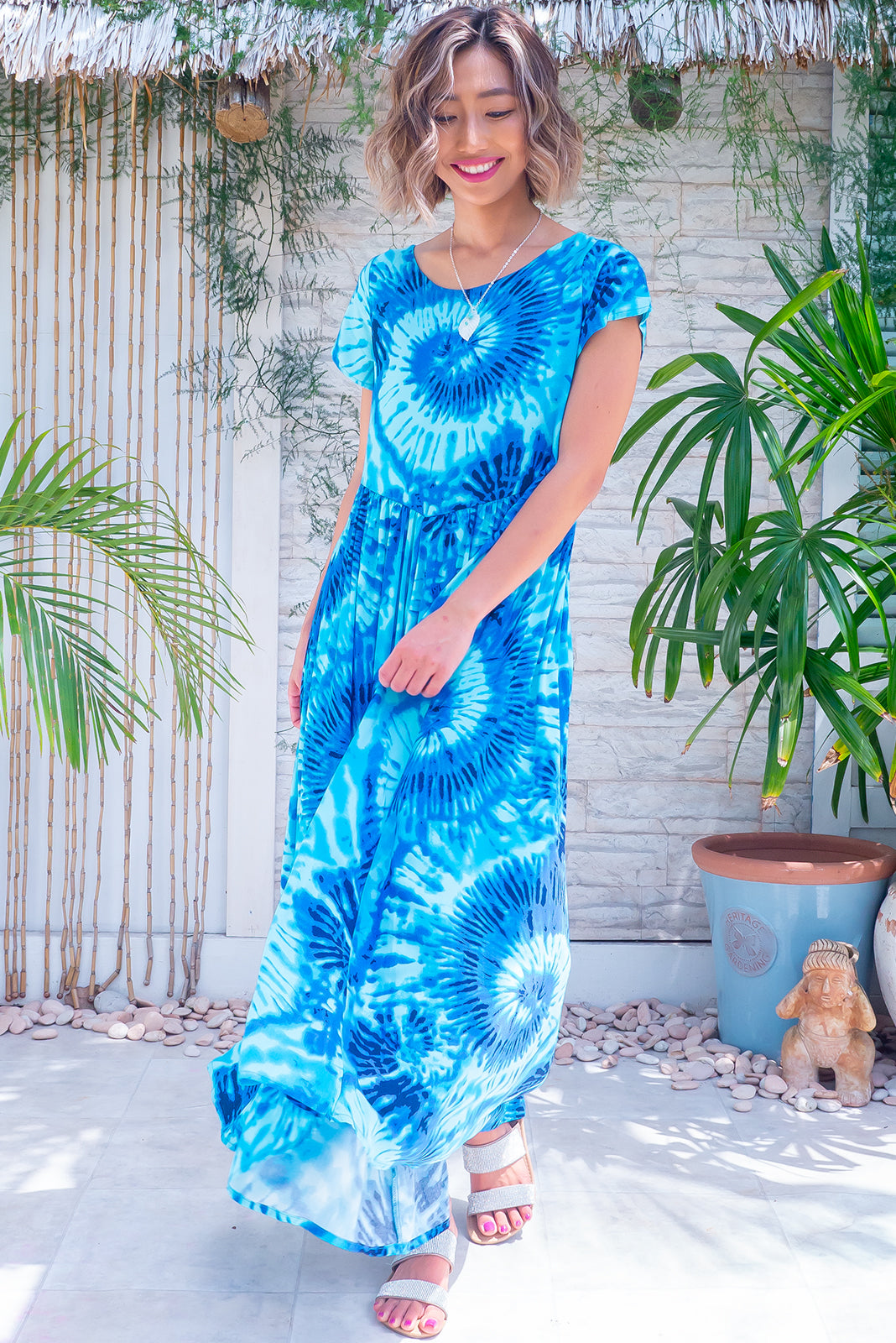 The Cocoloco Ocean Ripple Dress is a fun summer dress featuring lightweight/non-stretch fabric, short sleeves, side pockets and woven 100% rayon in vibrant blue swirl print.