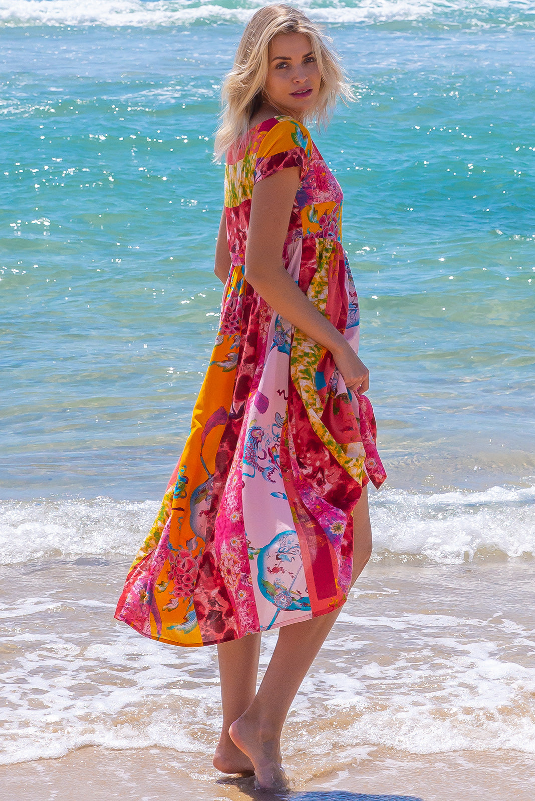 The Cocoloco Strawberry Fields Dress is a fun and bright dress featuring  side pockets, 100% cotton in bright & vibrant pink, red, peach multi-print.