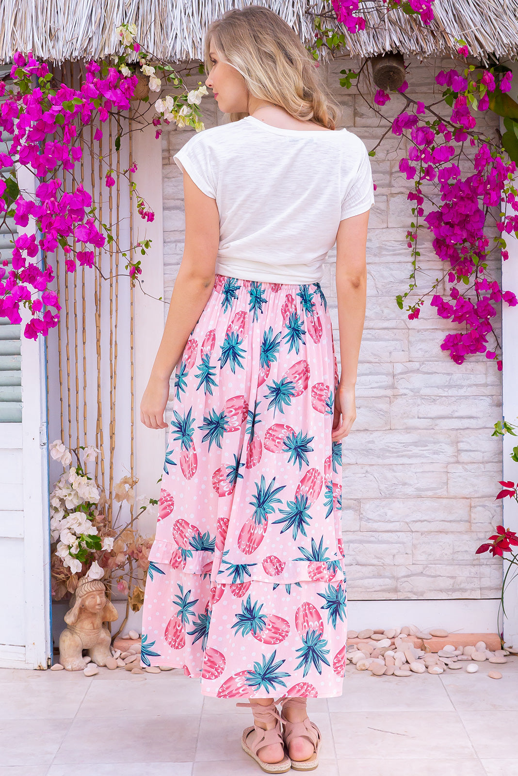 Coolum Pink Pine Skirt made in 100% rayon, fresh and breezy spring/summer design. Side pockets, button front and frill detail.