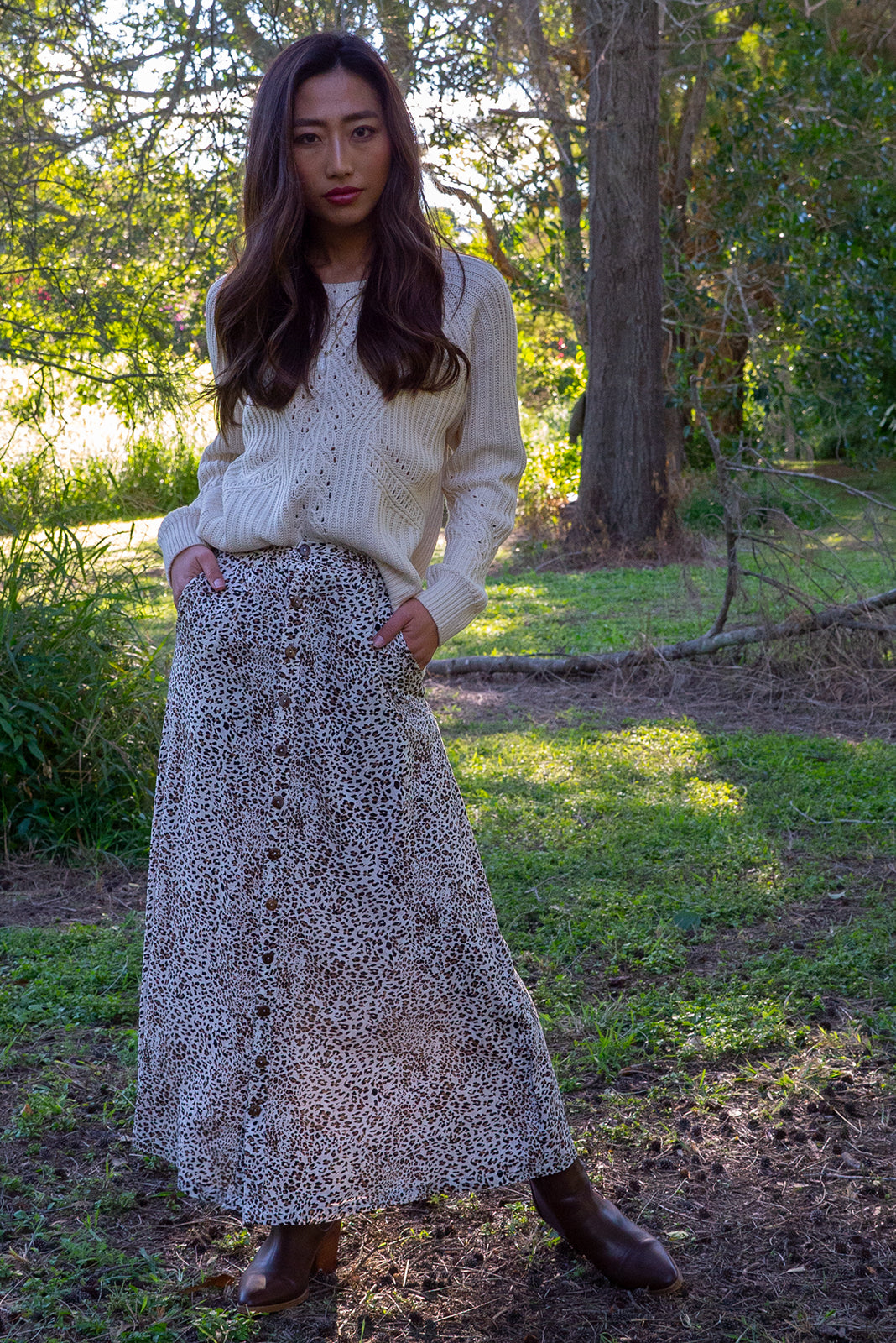 Chic, on trend Cosmos Hakuna Maxi Skirt. Vintage cream leopard print flowy skirt with deep side pockets. Comfortable fabric and functional button down front. 100% viscose.