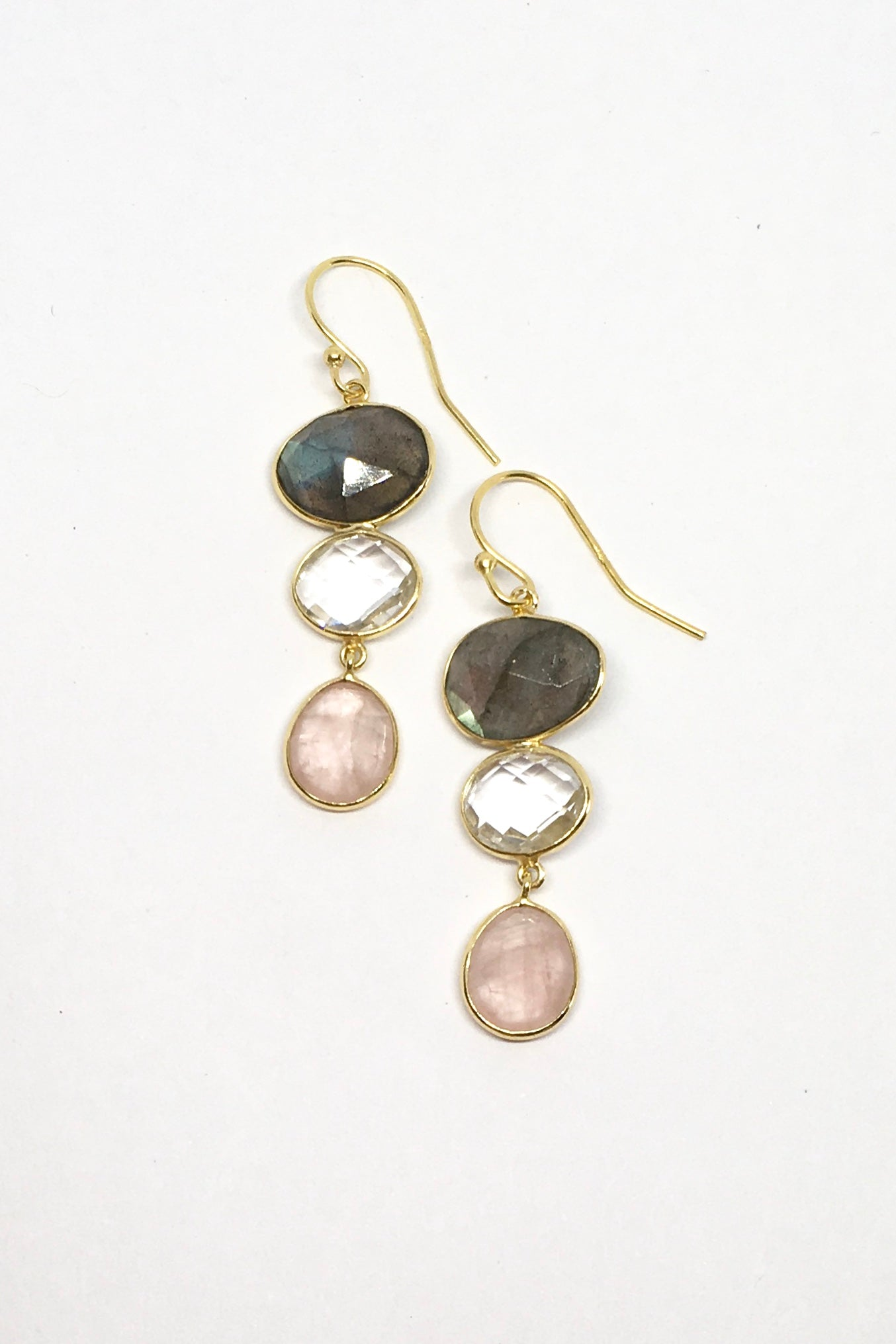 A modern bohemian inspired design of smokey toned crystal stones incased in gold vermeil