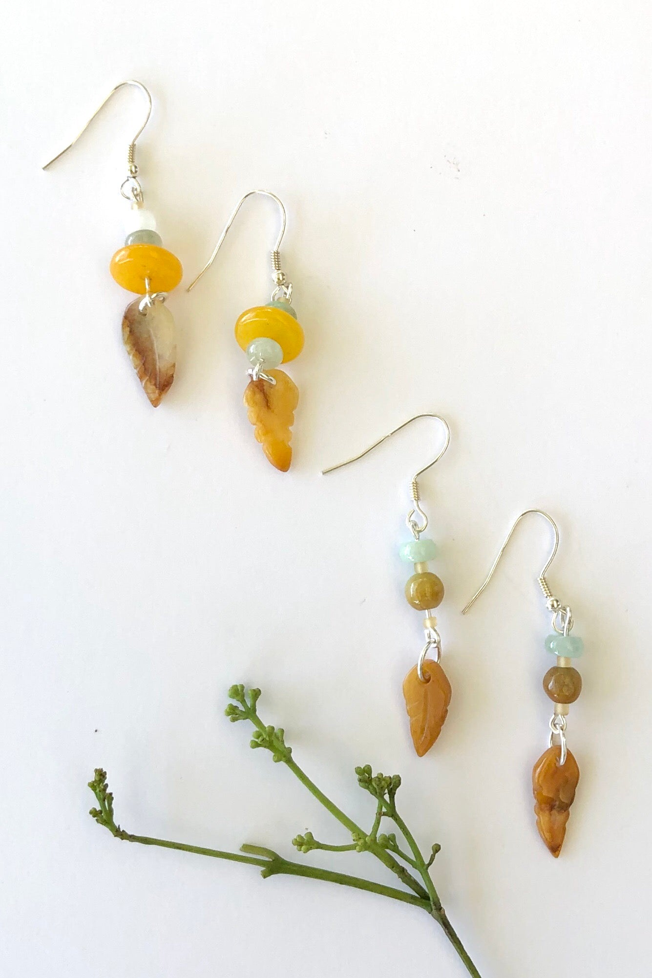 A tiny magical hand carved yellow jade leaf, every pair different