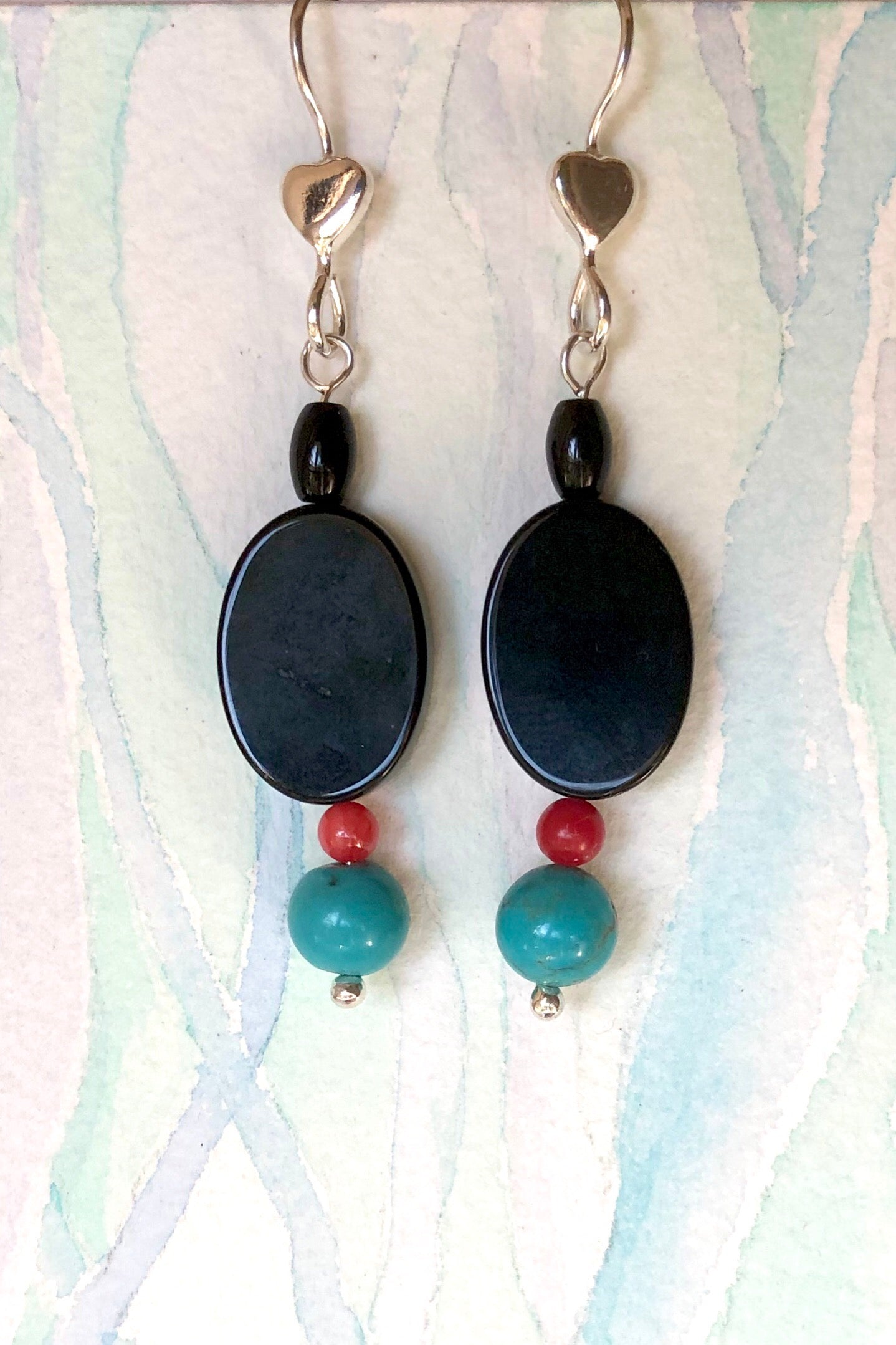 The Serendipity Earrings Black Heart  are handmade earrings featuring natural Black Onyx, natural Turquoise and red coral, hook is 925 Silver.