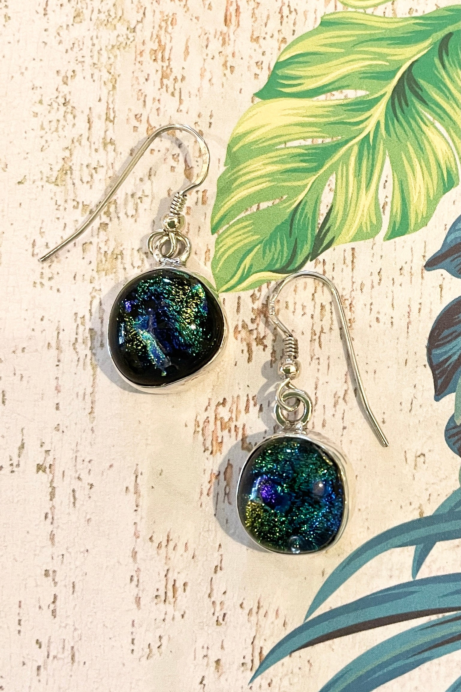 earrings made from iridescent Dichroic Glass bezel set in solid silver