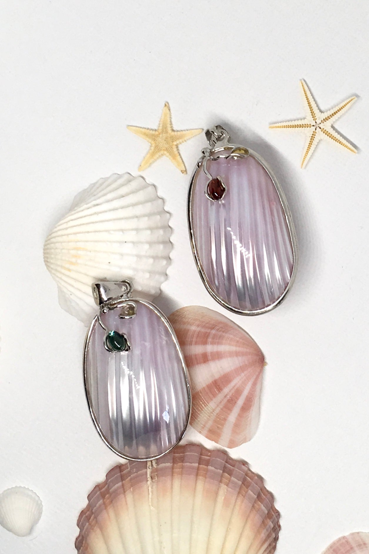 sweet gentle shell pendant, highly polished to enhance the grain of the sea shell