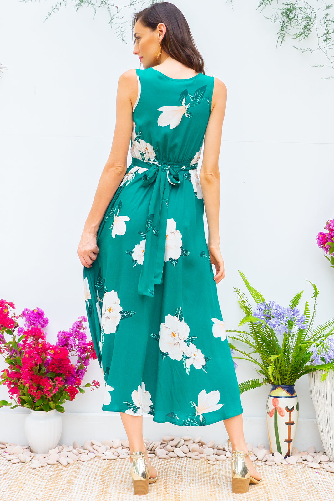 Darling Emerald Green Dress tie front wrap dress with an elastic waist and a plunging v neckline made from a 100% rayon fabric in a stunning deep emerald green and gardenia print