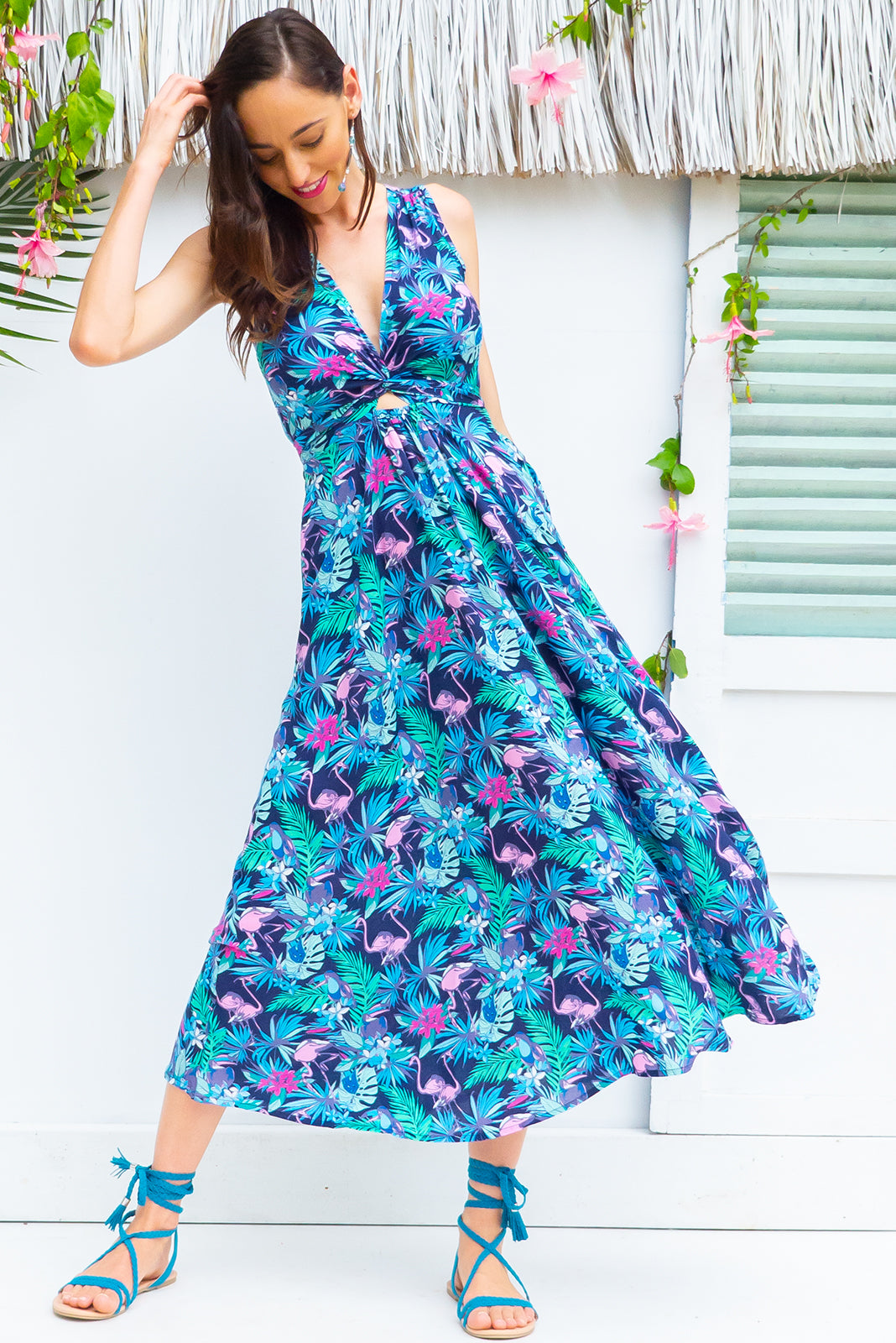 Darling Flamingo Blues Dress tie front wrap dress with an elastic waist and a plunging v neckline made from a 100% rayon fabric in a stunning navy based tropical floral and flamingo print