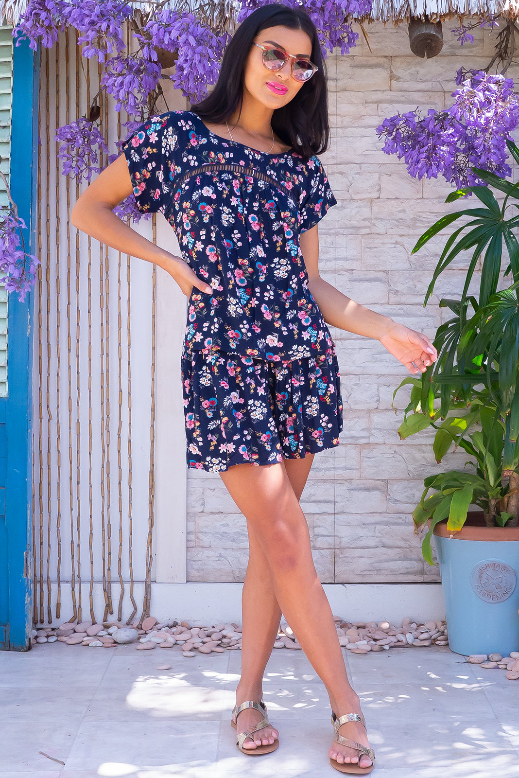 Comfortable pull-on style shorts, the Day Tripper Newport Navy Shorts has elasticated back waistband, flouncy gathers on legs, side pockets and 100% viscose in navy base with cute floral print.
