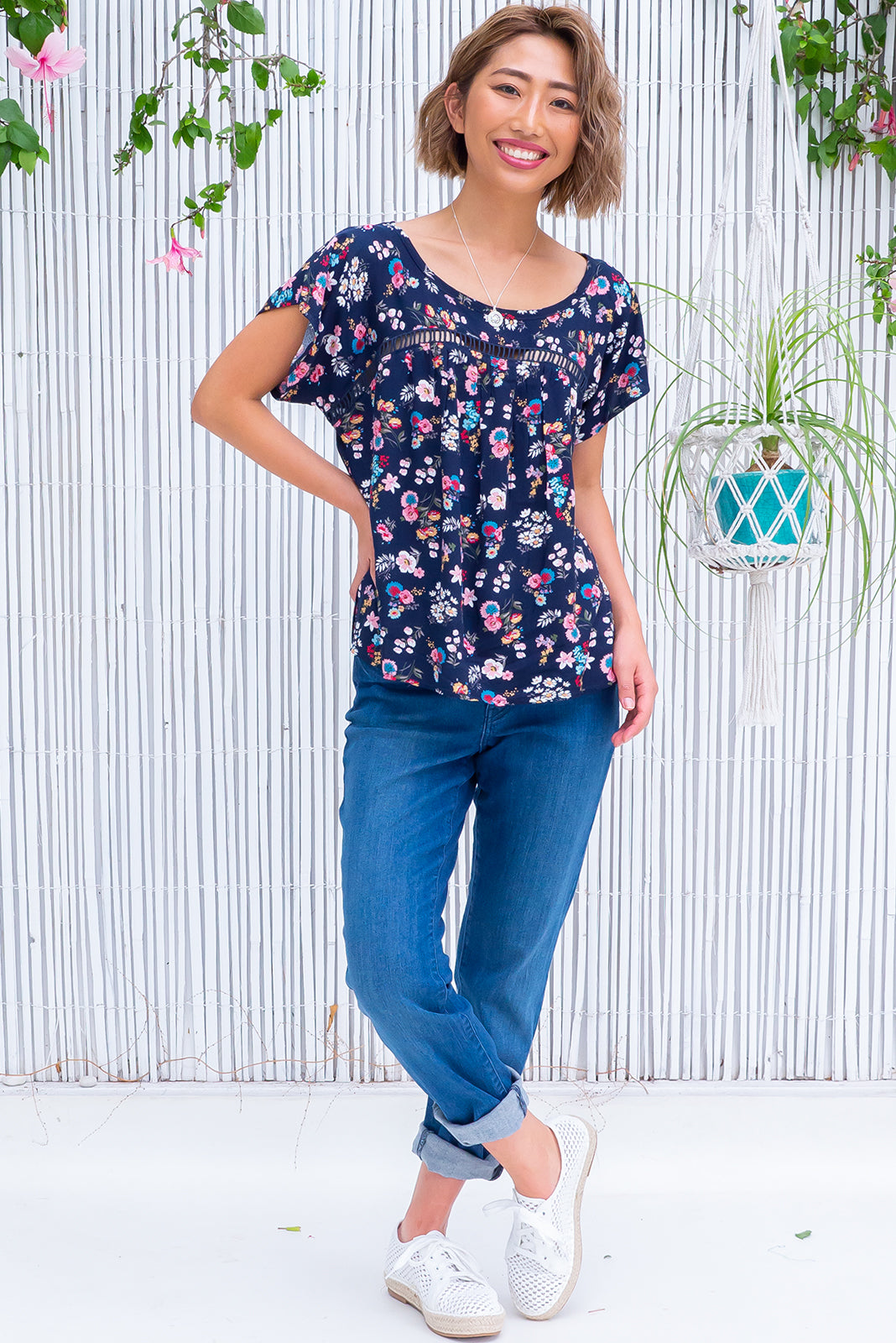 The Day Tripper Newport Navy Top is an airy, bloused fit top, designed to be worn soft and loose featuring scooped neckline, lace insert across chest, cap sleeves and 100% viscose in navy base with sweet floral print.