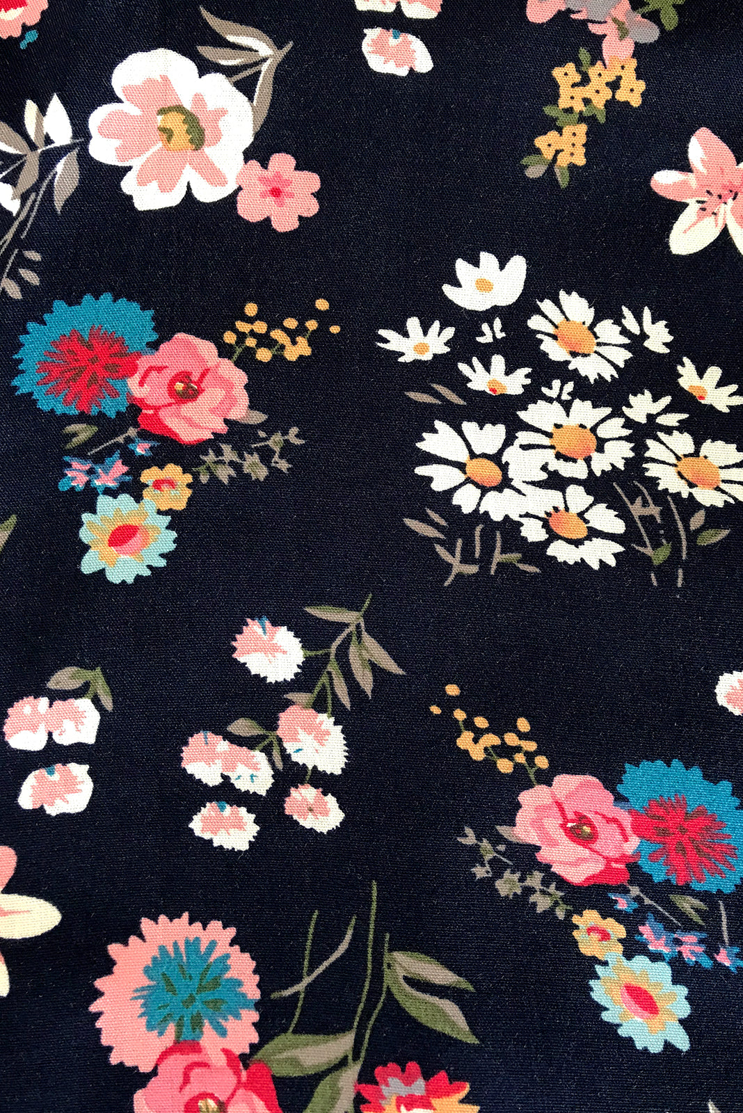 Fabric Swatch of Day Tripper Newport Navy Top featuring 100% viscose in navy base with sweet floral print.
