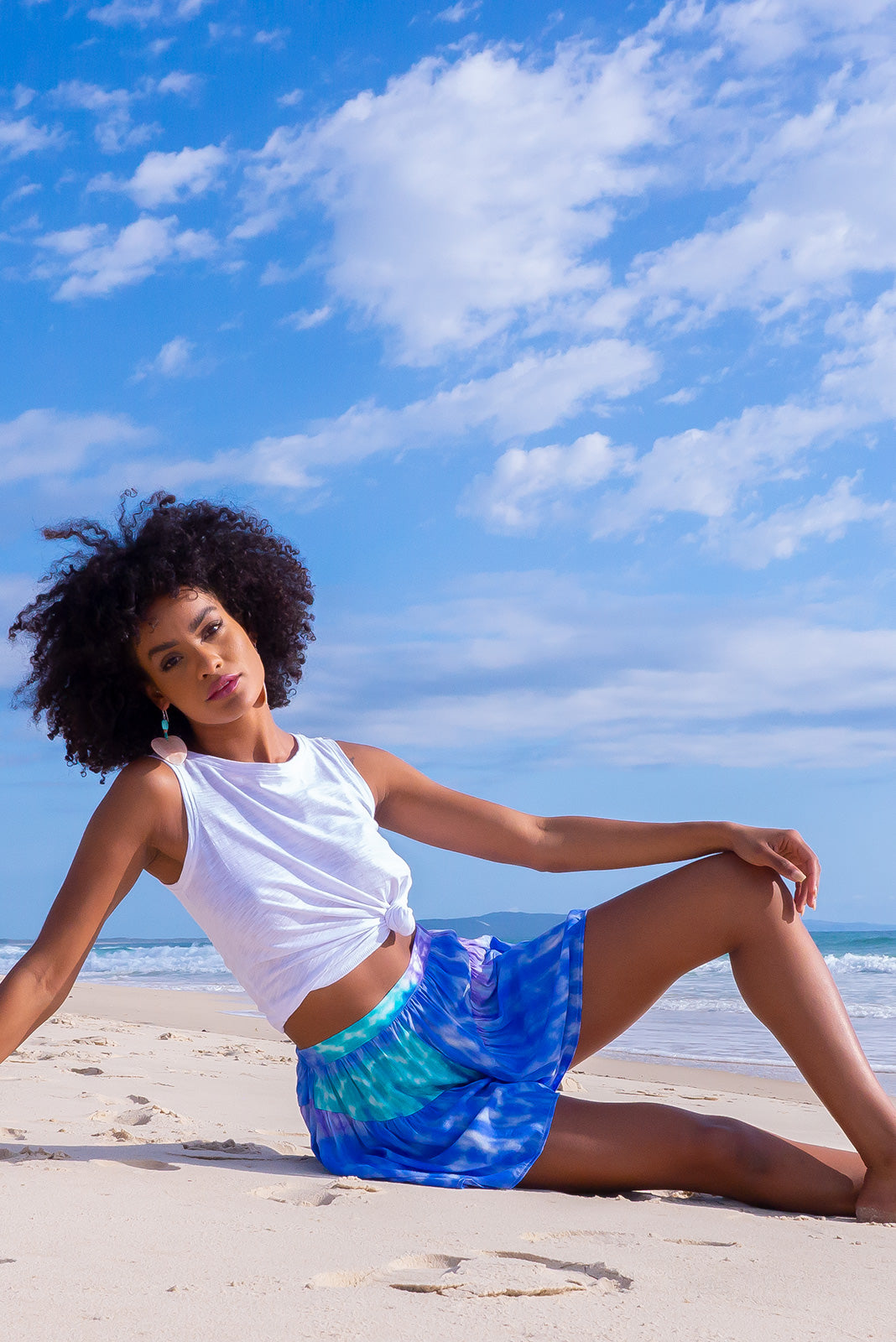 The Day Tripper Ocean Ripple Shorts are trendy tie dye shorts featuring 100% viscose in rippled cosmic tie dye of blue, white, sea green and purple and have elasticated back waistband, comfortable pull-on style, flouncy gathers on legs, side pockets.