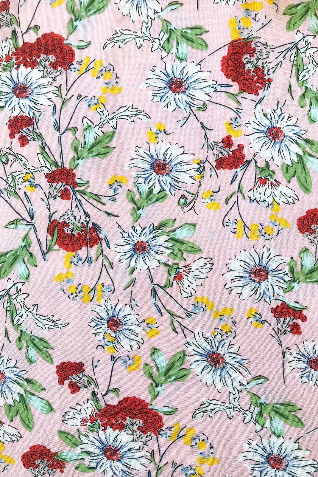 Fabric Swatch of Day Tripper Pink Perfection Top featuring 100% viscose in pale pink base with daisy and sweet wildflower print.