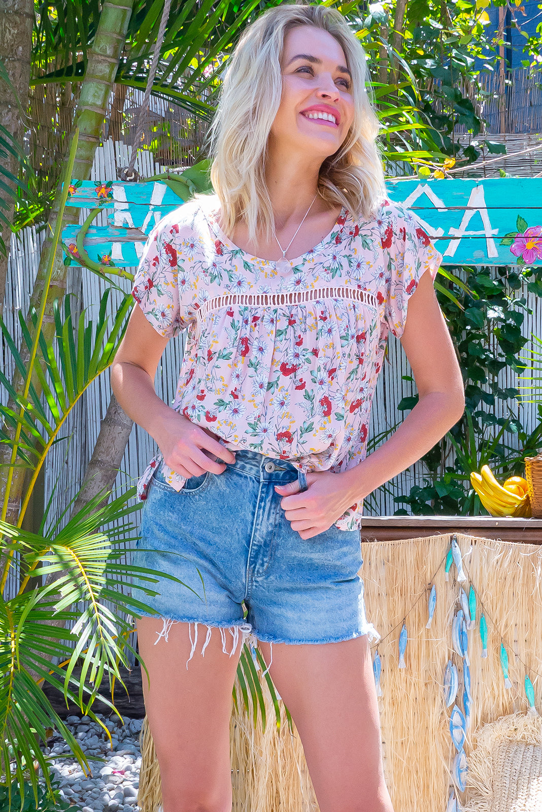 The Day Tripper Pink Perfection Top is lightweight, airy and bloused fit design featuring Scooped neckline, lace insert across chest, cap sleeves, small split in side seams for comfort and 100% viscose in pale pink base with daisy and sweet wildflower print.