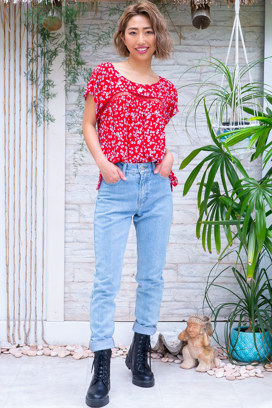 The Day Tripper Real Red Top is an airy and comfortable 100% viscose top featuring red base with small flowers and has scooped neckline, lace insert across chest.