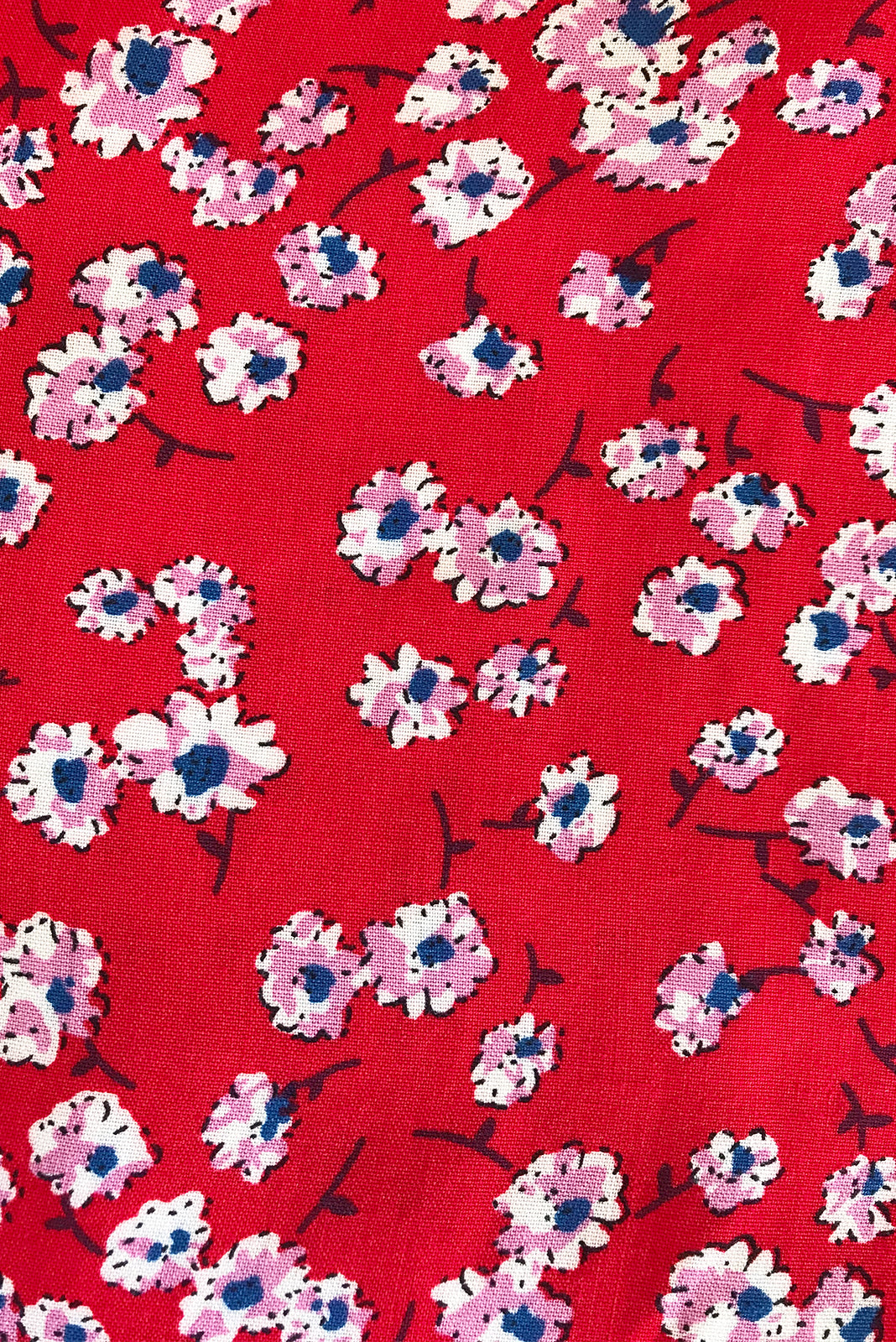 Fabric Swatch of  Day Tripper Real Red Top featuring 100% viscose in red base with small flowers.