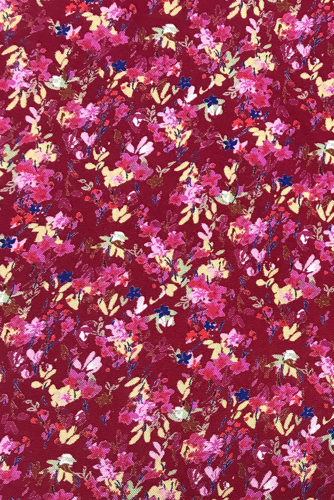 Fabric Swatch of Daydreamer Rouge Maxi Wrap Dress featuring woven 100% rayon in Scarlet red base with colourful leaf print.
