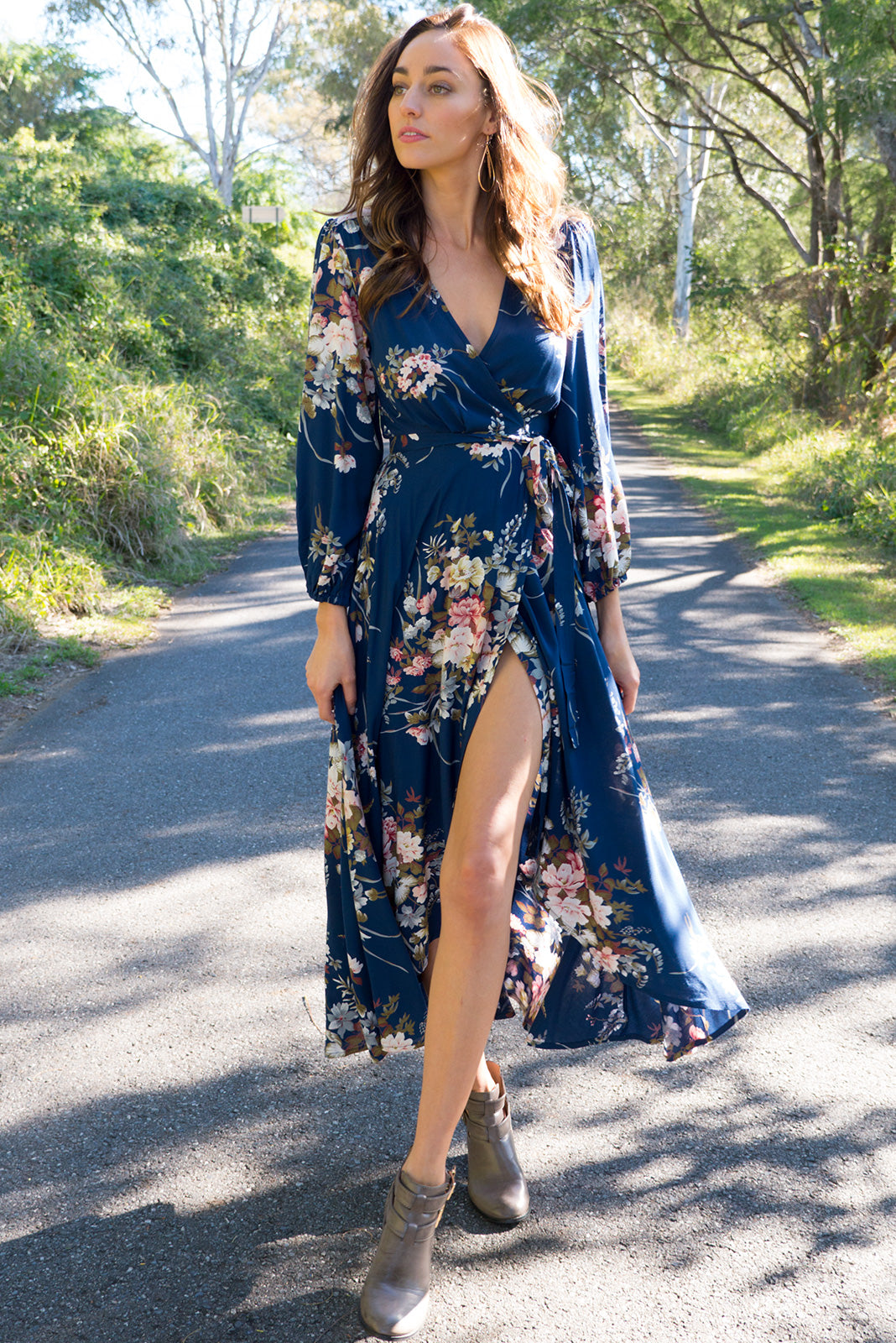 Daydreamer Navy Bouquet Maxi Wrap Dress with a full length sleeve in a wrap around style in a romantic bohemian floral print on a dusky navy base on a soft woven rayon fabric