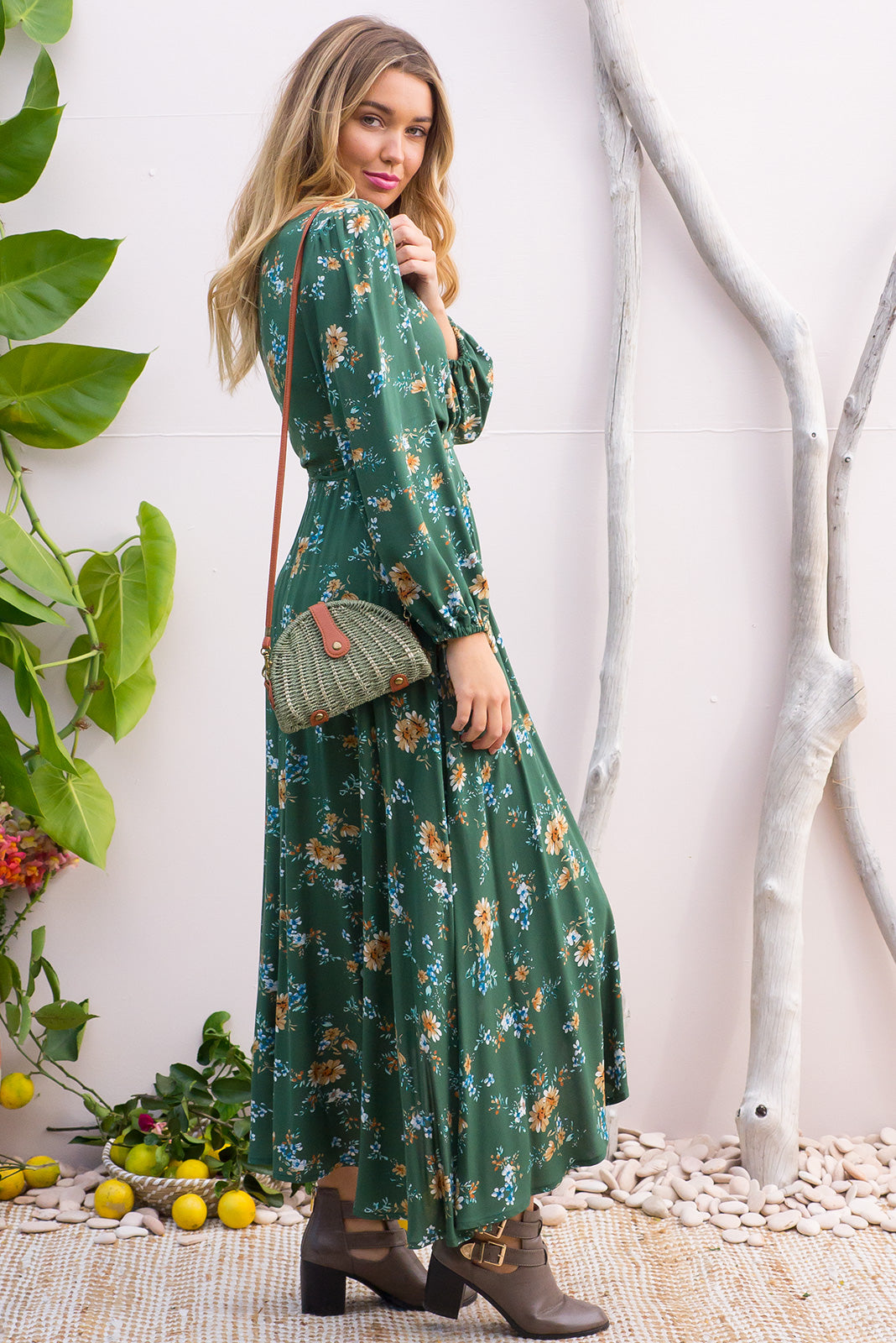 Daydreamer Green Maxi Wrap Dress with a full length sleeve in a wrap around style in a romantic bohemian floral print on a dusky green base on a soft woven rayon fabric