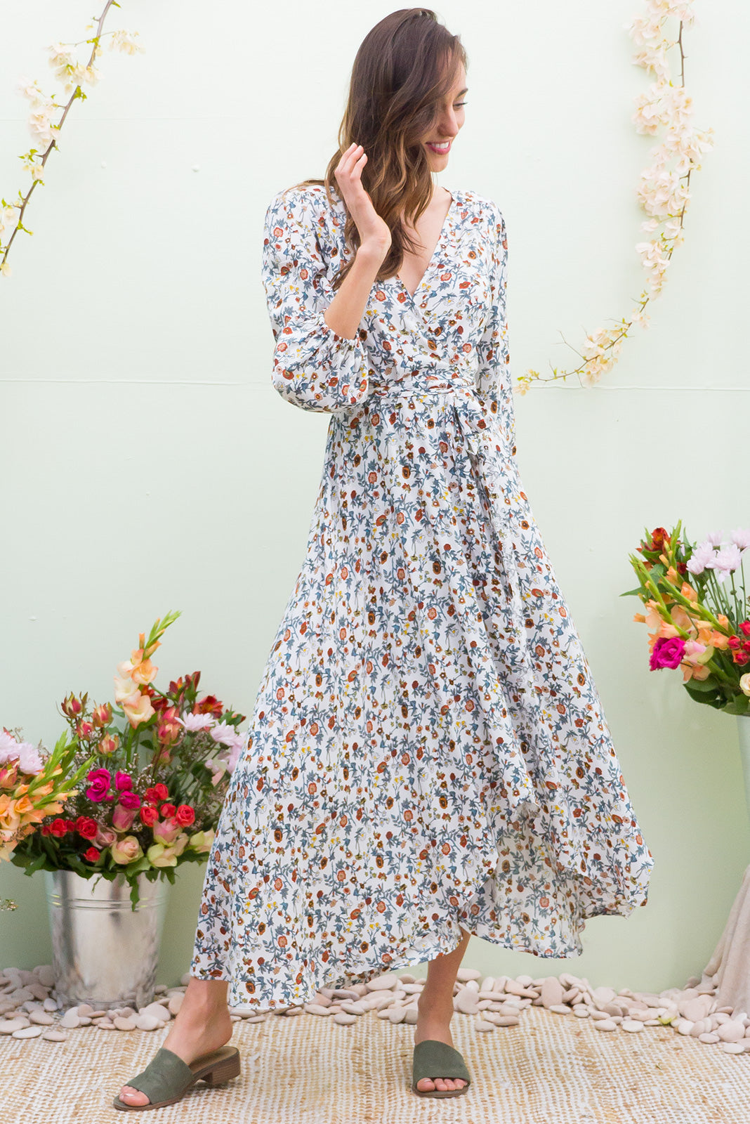 Daydreamer Paper Daisy Maxi Wrap Dress with a full length sleeve in a wrap around style in a delicate wild flower print on classic white on a soft woven rayon fabric