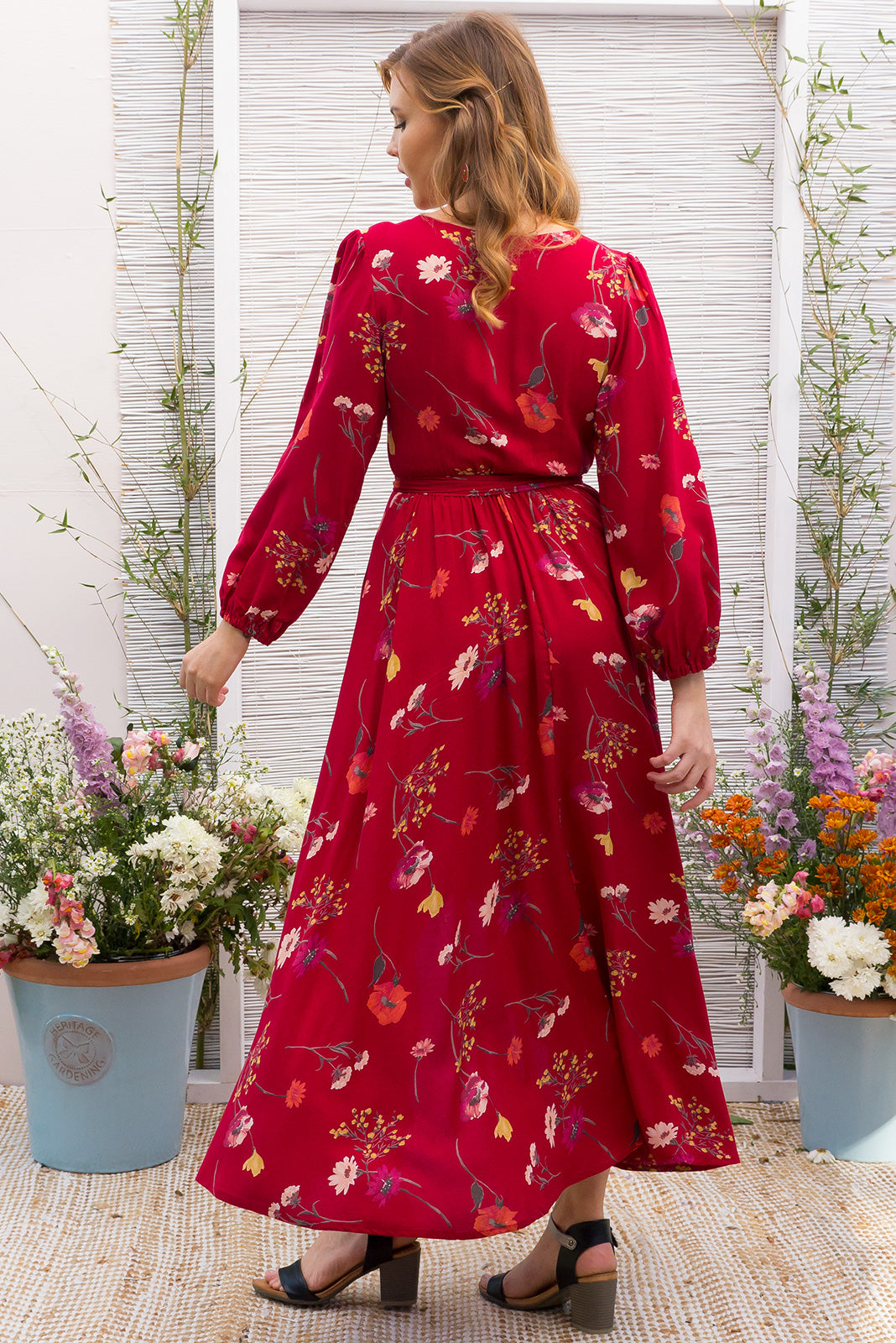 Daydreamer Ruby Red Maxi Wrap Dress with a full length sleeve in a wrap around style in a bold red floral print on a soft woven rayon fabric