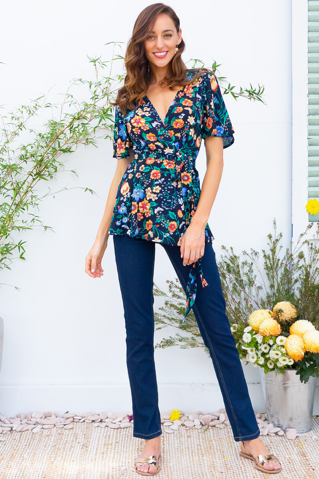 Delta Flight Navy Top in a bright navy floral  print has petal sleeve and wrap around waist