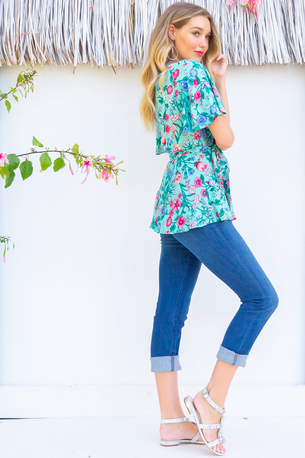 Delta Minty Meadow Wrap Top in a minty blue fun floral print has petal sleeve and wrap around waist