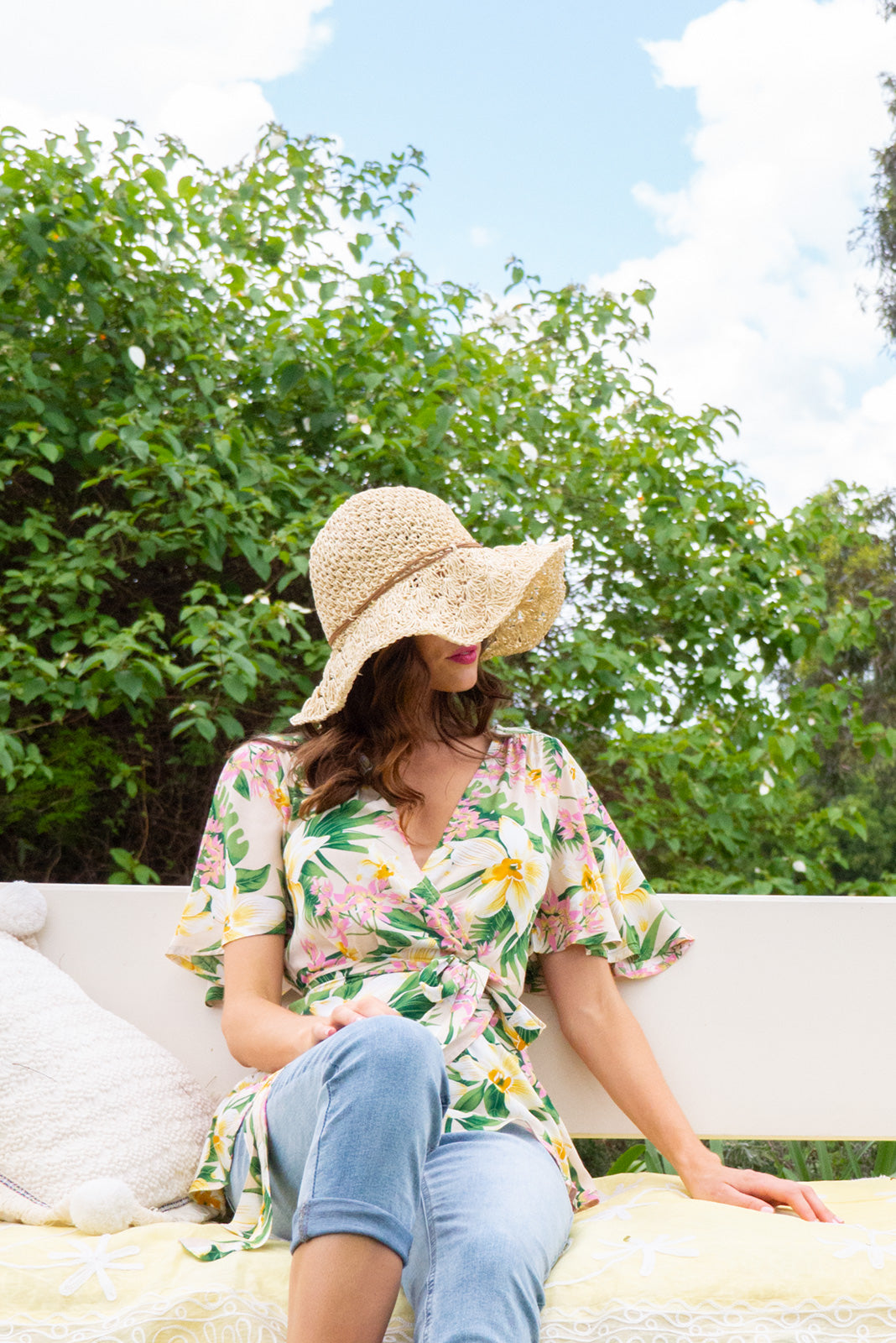 Delta Perfect Pastel Wrap Top in a creamy yellow tropical floral  print has petal sleeve and wrap around waist
