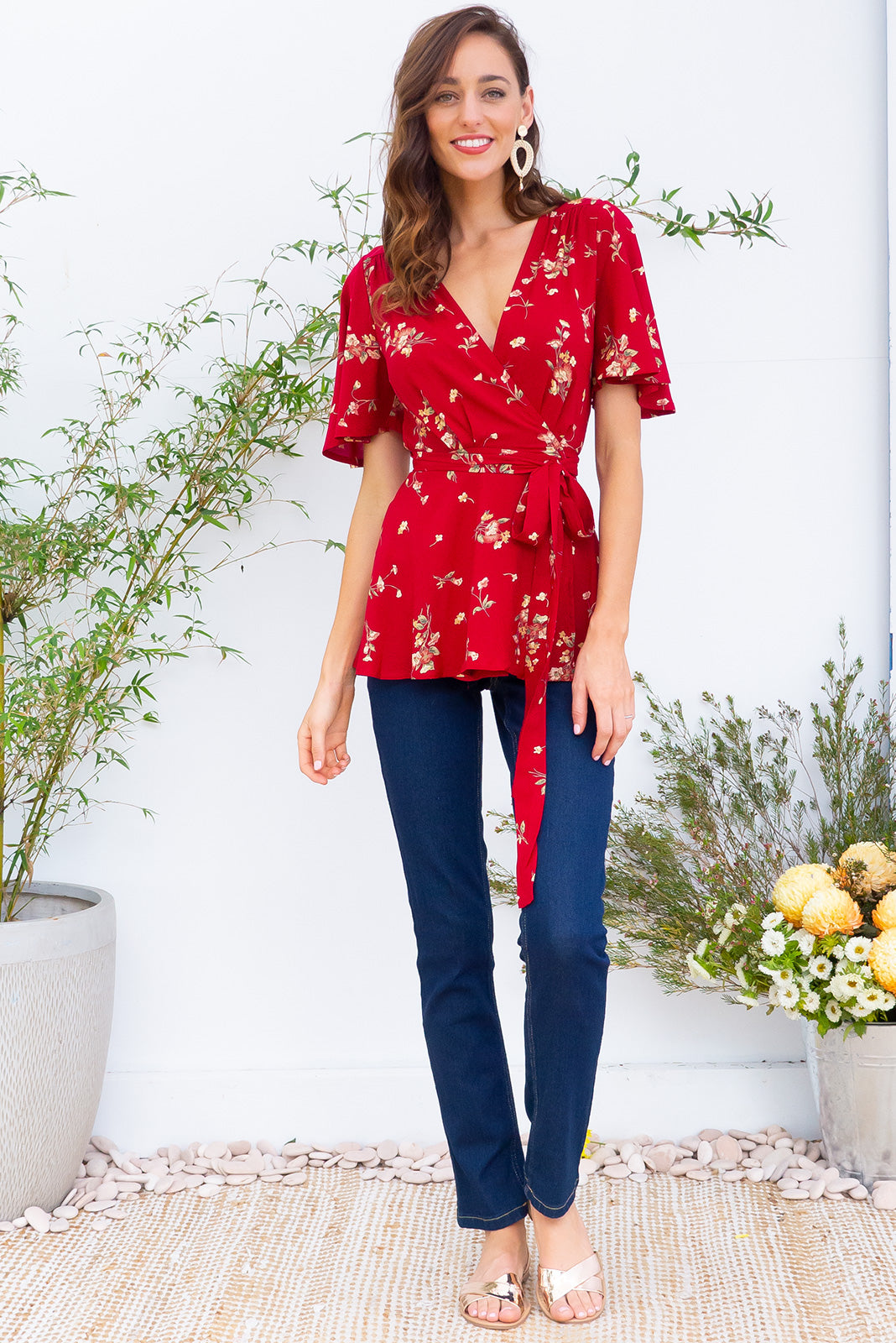Delta Red Daze Wrap Top in a bright red floral  print has petal sleeve and wrap around waist