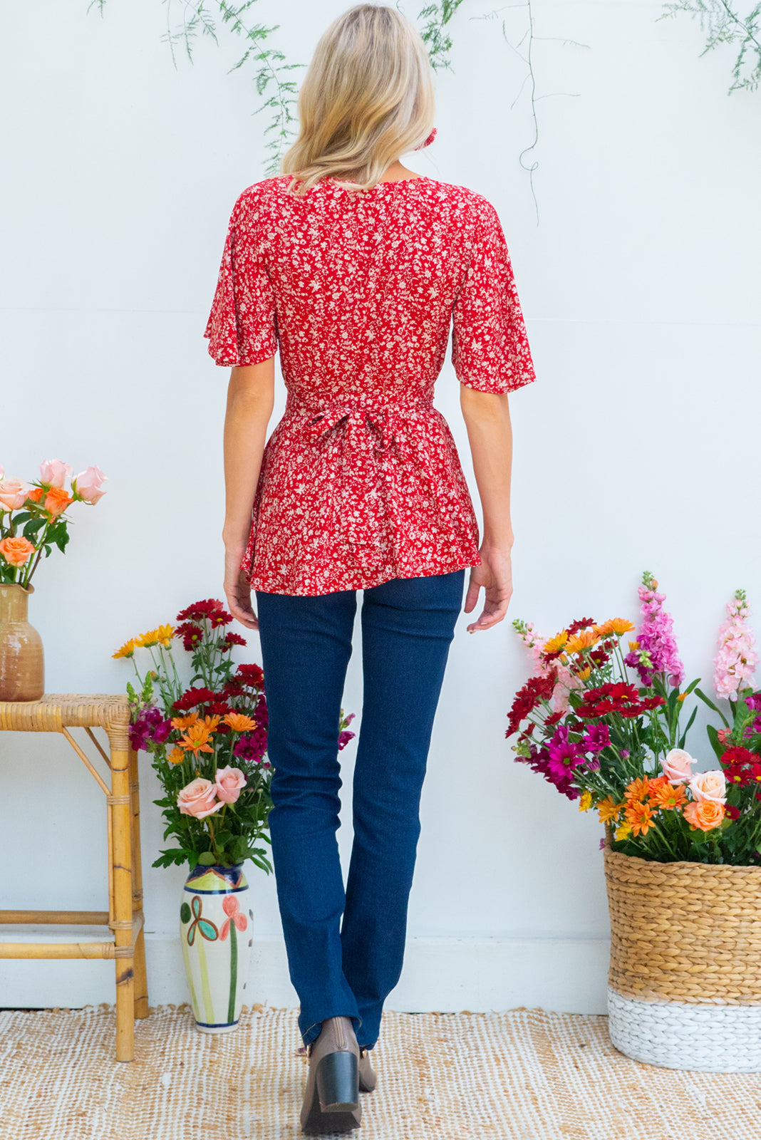 d5bc2f50f5772e Delta Red Earth Wrap Top in a rusty red floral print has petal sleeve and  wrap