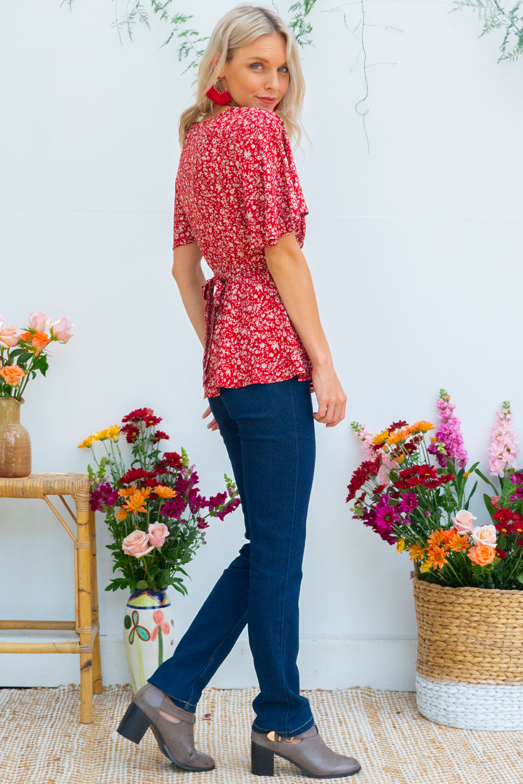 Delta Red Earth Wrap Top in a rusty red floral  print has petal sleeve and wrap around waist