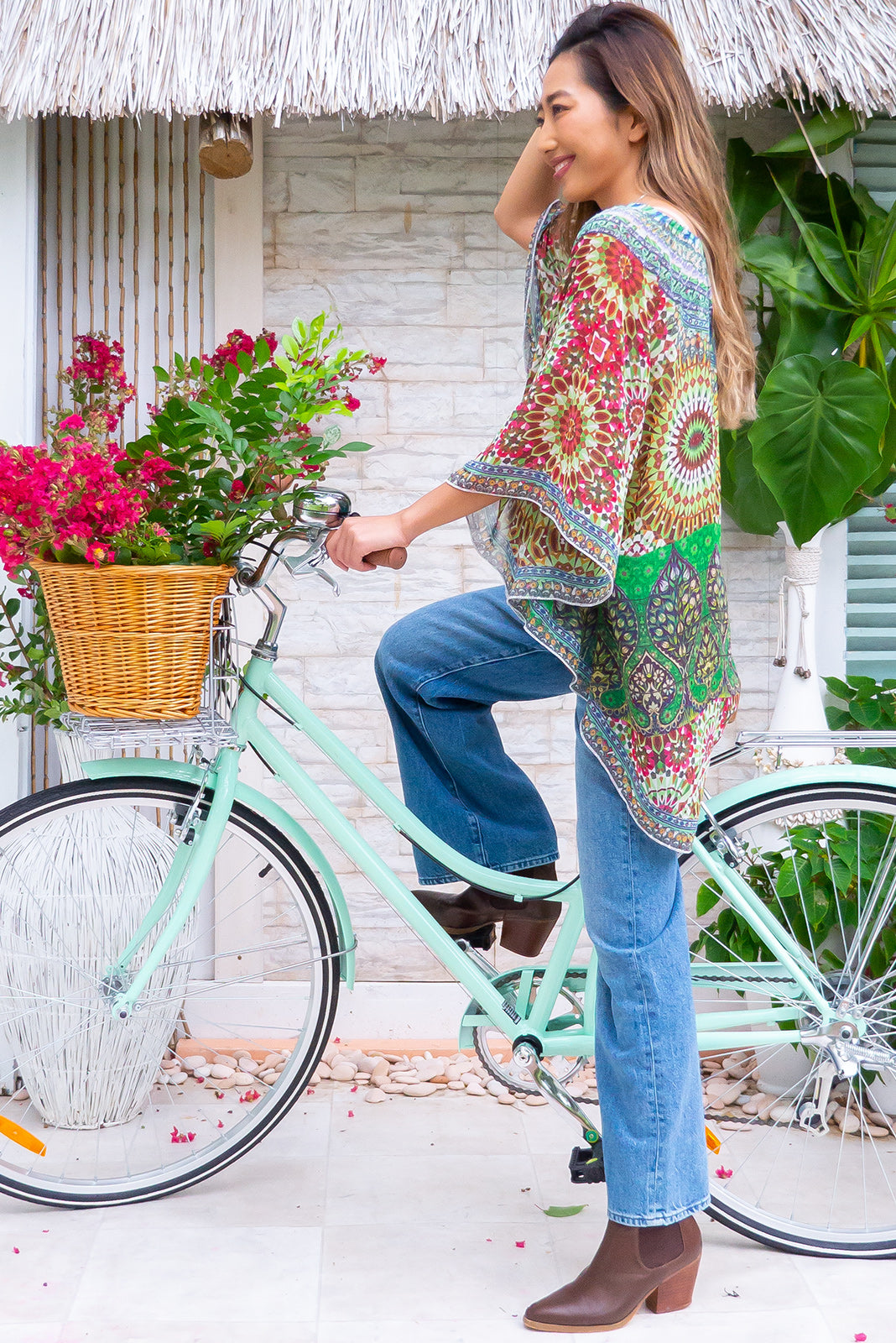 The Destiny Fore Caftan is a nice loose-fit caftan top featuring true circle caftan cut, embellishments scattered across front, kaleidoscope print in magenta, white, cobalt, orange and greens in 100% polyester chiffon.