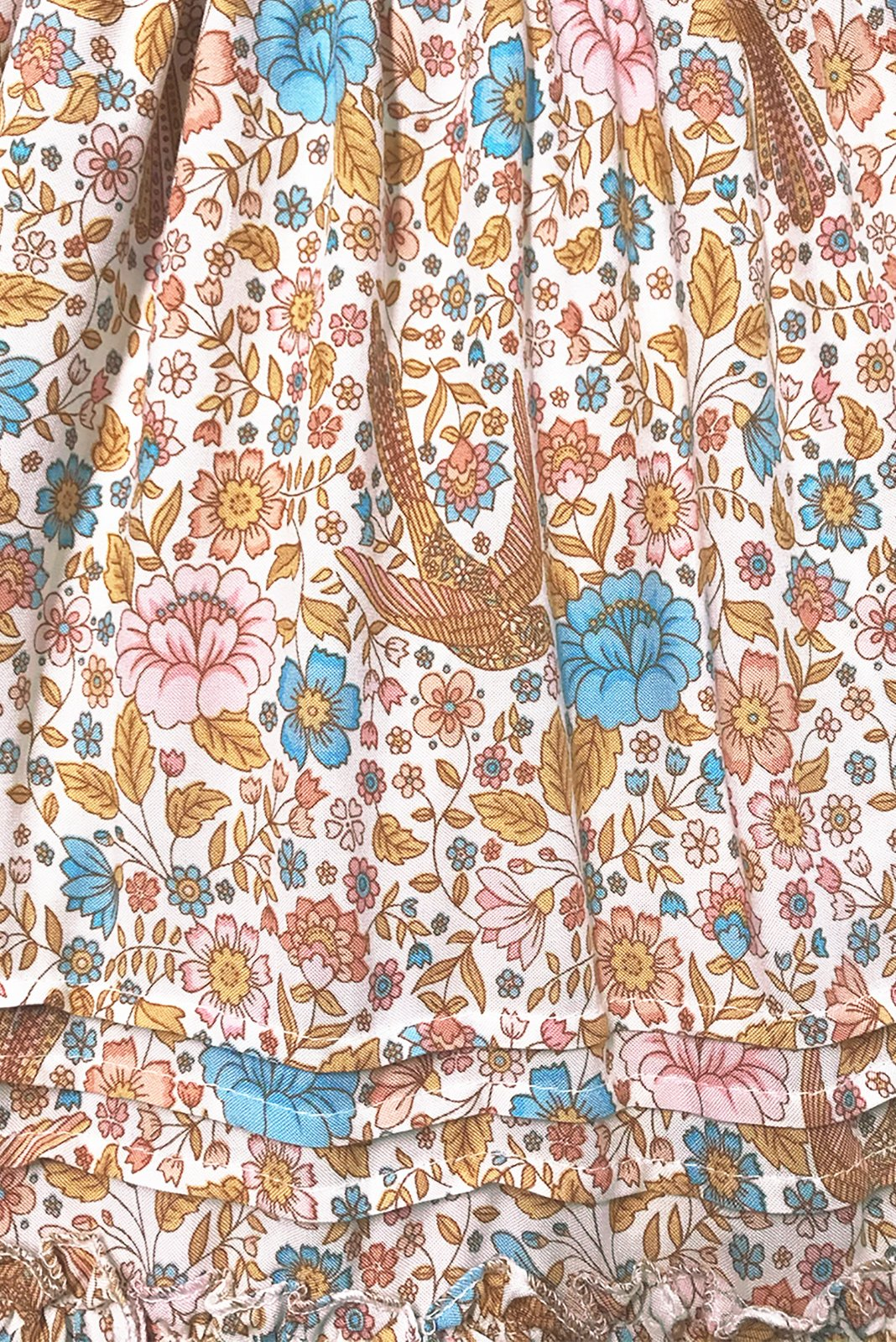 Dorothy Cream Midi Dress's fabric swatch featuring cream base with folk/bohemian print in pinks, blue, beige and amber tones in woven 100% rayon.