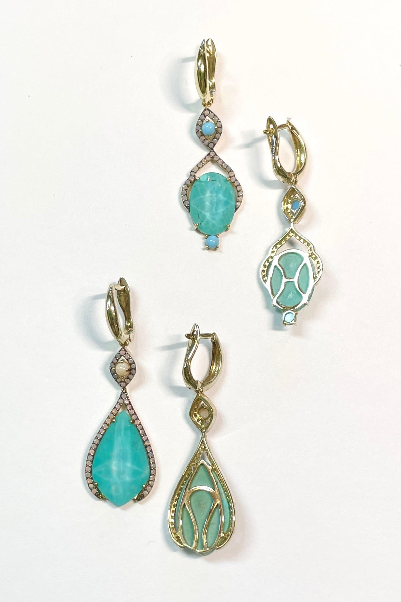 earrings are made from a faceted conceptual doublet made with a sliver of Turquoise gemstone with rock crystal applied to the top give depth and sparkle.