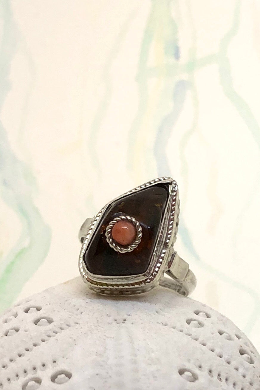 The Echo Ring Amber Coral is set in 925 silver with a centre bead of Nepalese coral.