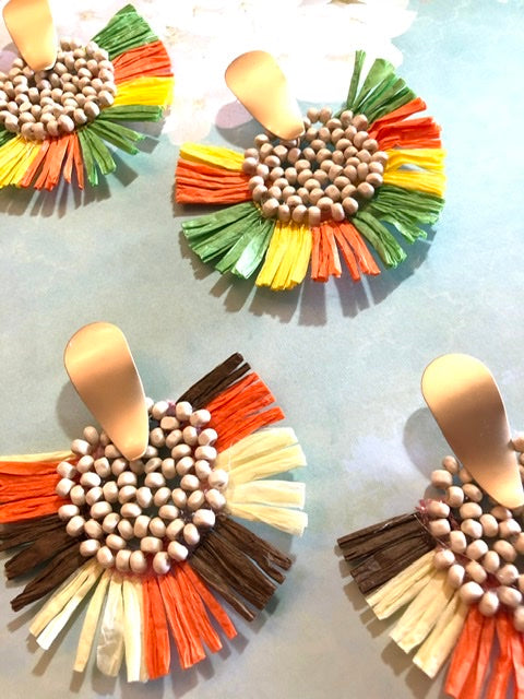 raffia island style earrings. With a cute party vibe