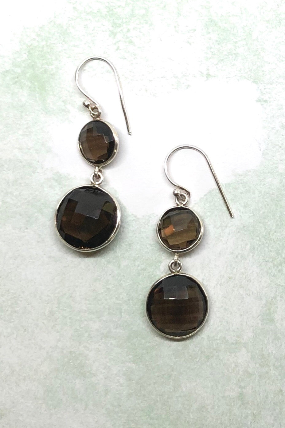 Earrings Smokey Quartz Circles are drop style earrings featuring smokey Quartz gemstones and silver hook fitting.