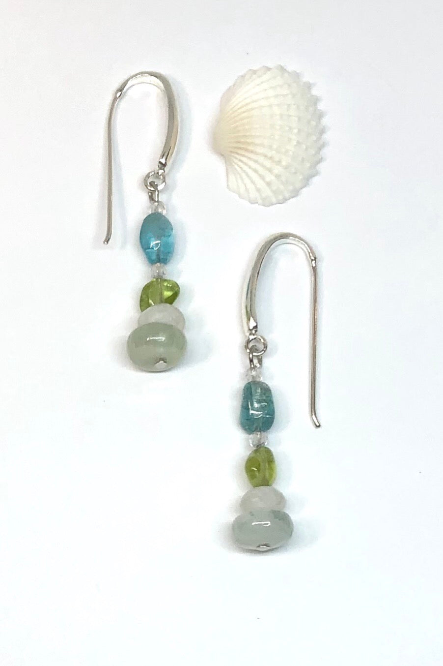 The Earrings Serendipity Pretty Six are handmade in Noosa, Australia featuring peridot, moonstone and quartz crystal.