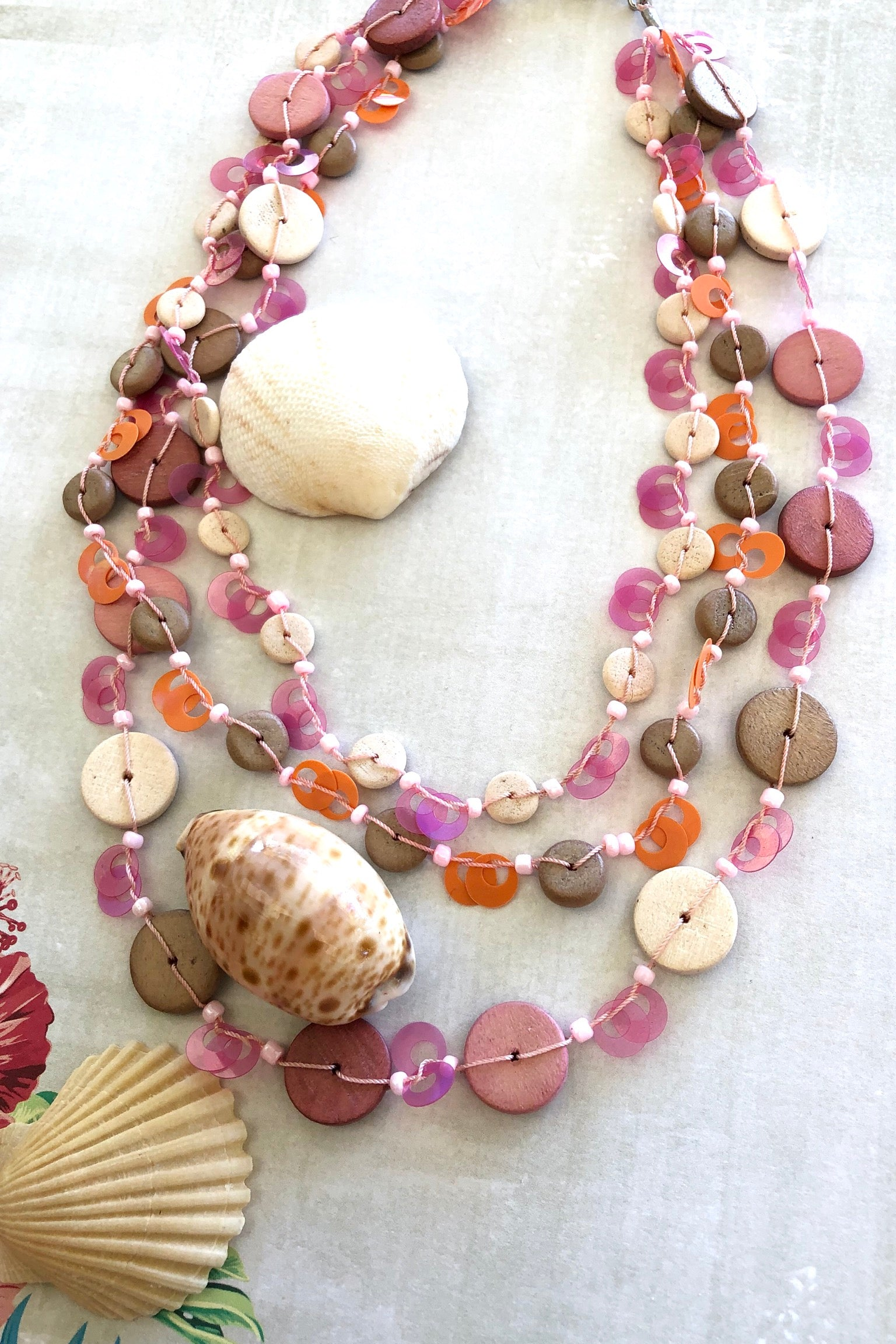 This three strand Necklace Coco Beach is made from hand cut coconut shell beads in pale Mauve pink and cream made in The Philippines.