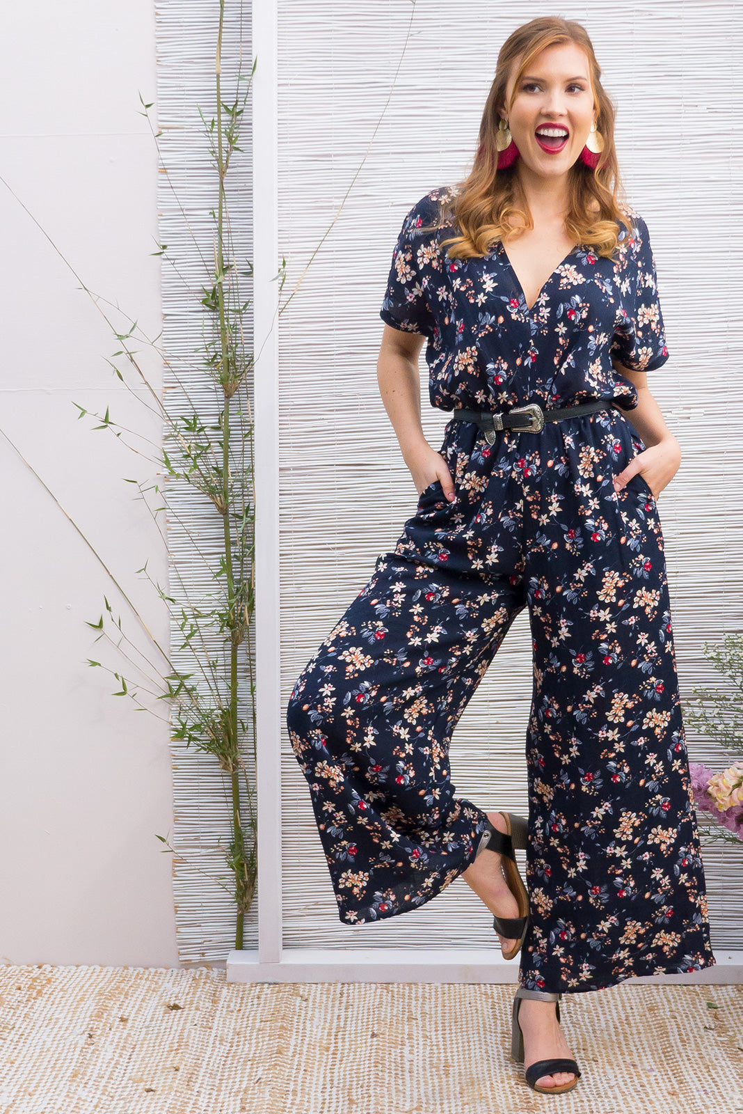 Eclipse full length Jumpsuit with a easy fit elastic waist and tie back in a dark bright ditzy floral print on a navy base in a easy care rayon polyester blend fabric