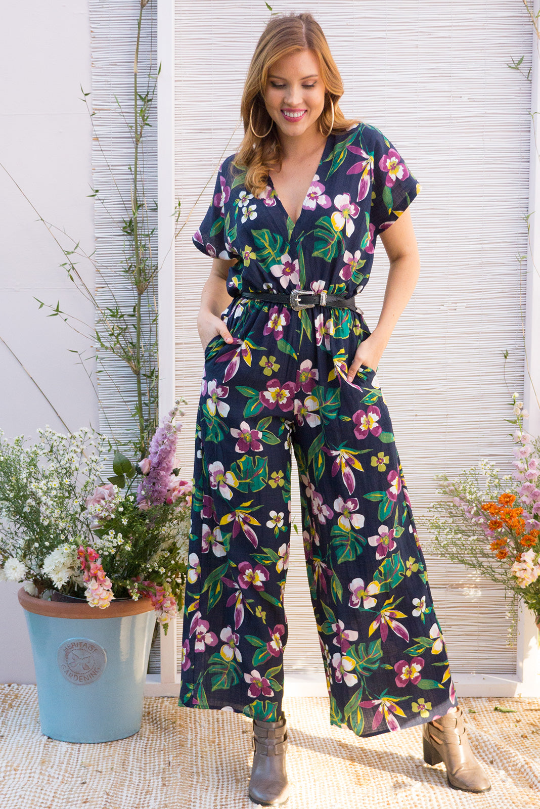 Eclipse Jumpsuit in a dark bright tropical print on a navy base with an elastic waist