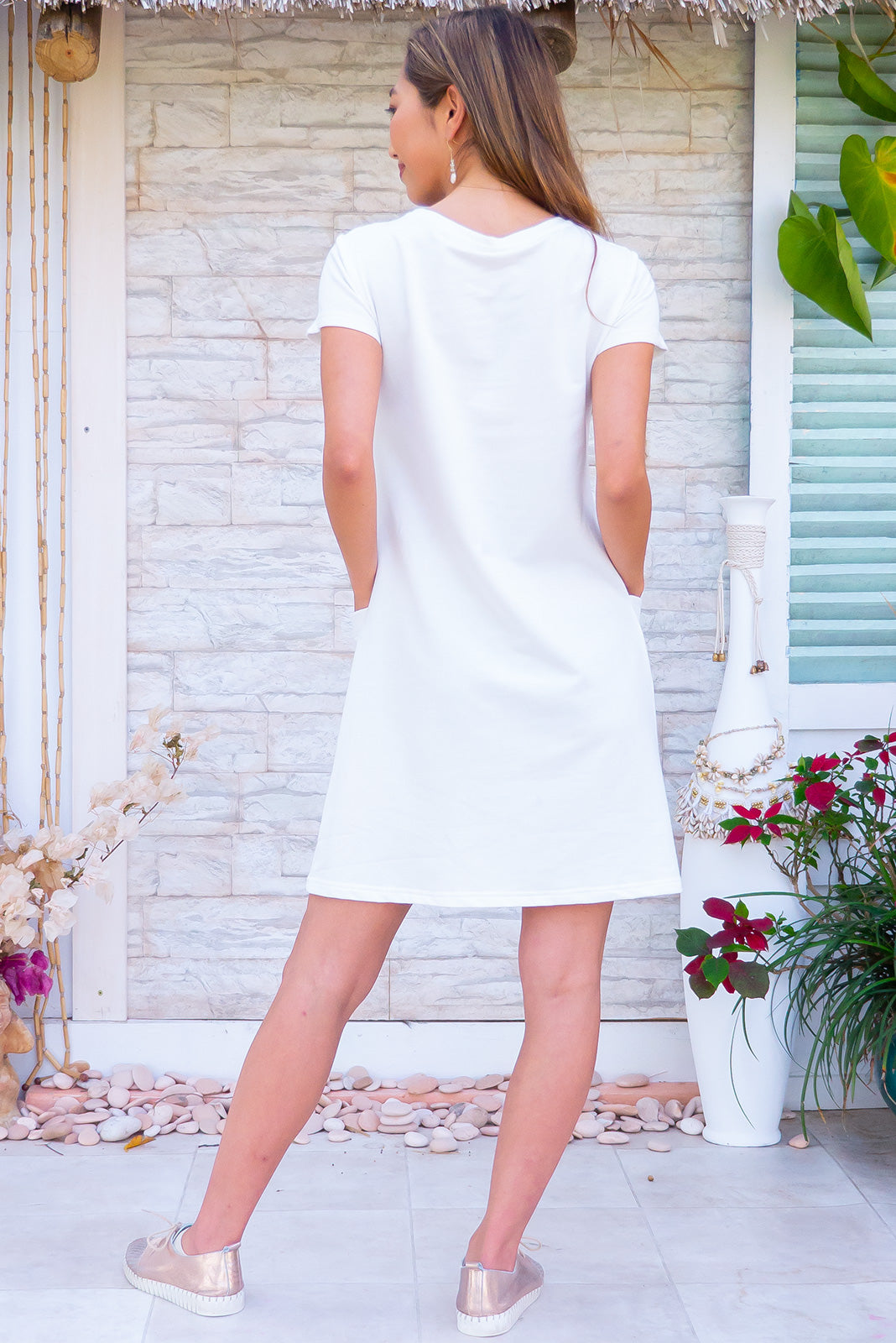 Elsa Pearl White Dress Sports Luxe shift dress in cotton/polyester blend with pockets.