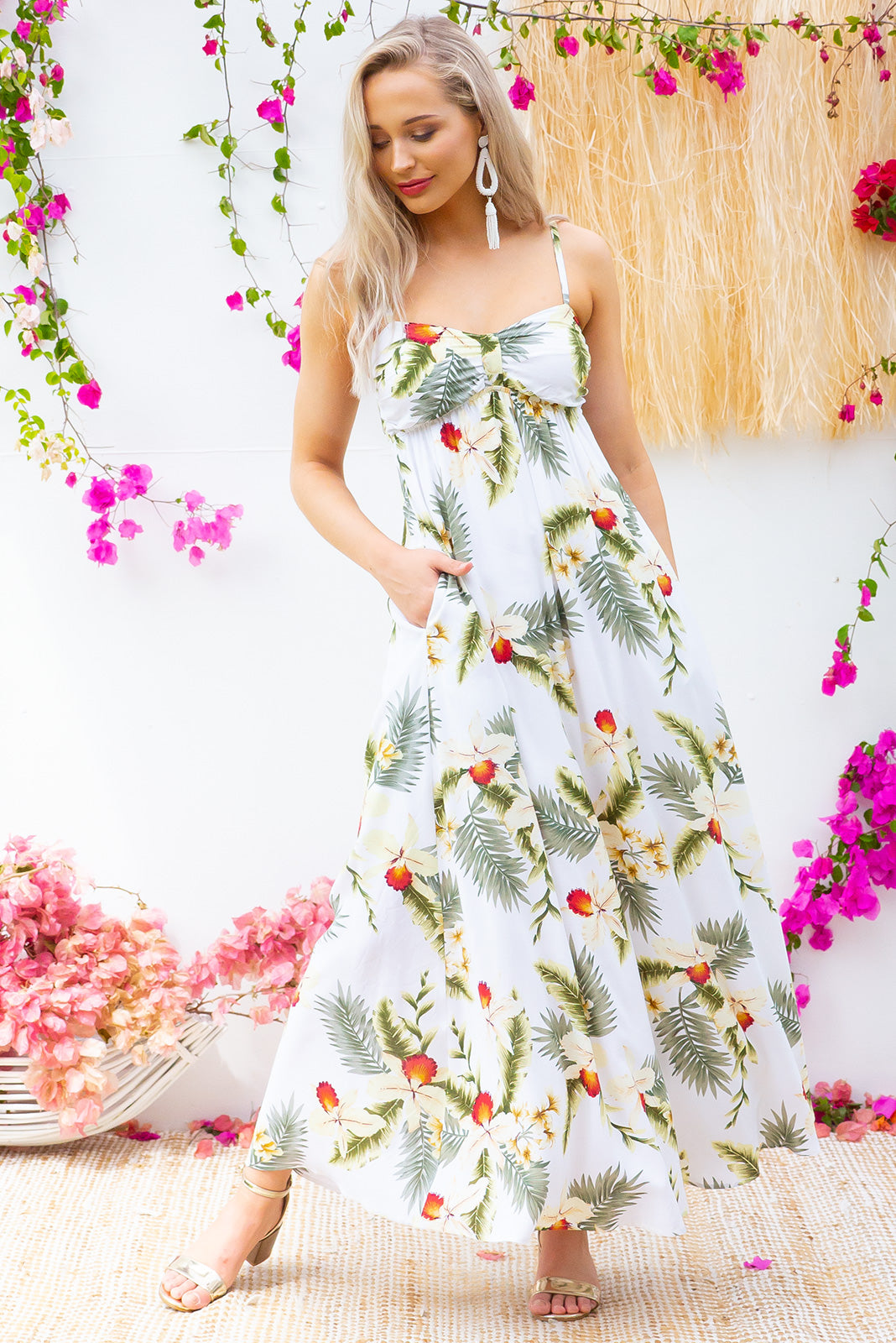Emmy Aloha Pearl Maxi Dress features a flattering empire line with thin shoulder straps and side pockets in a classic light cream and tropical print on woven 100% rayon