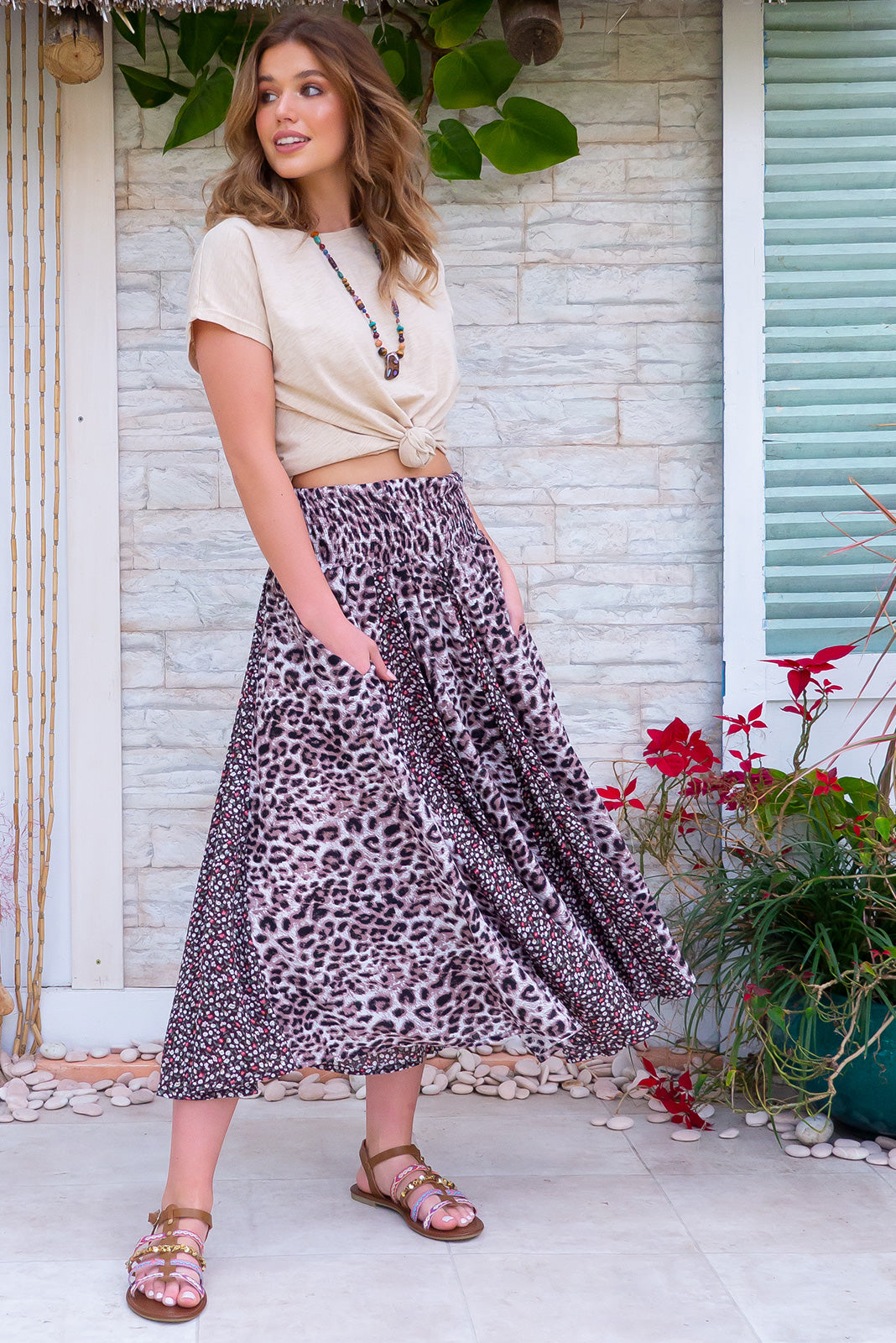 Etosha Sable Wild Skirt - Bohemian leopard and floral skirt in cocoa and neutral tones made from 100% rayon fabric. Breathable and light, comfortable to wear. Includes side pockets and an elastic shirred waist band. Midi length with fishtail inserts for full circle skirt effect. Designed in Brisbane, Australia