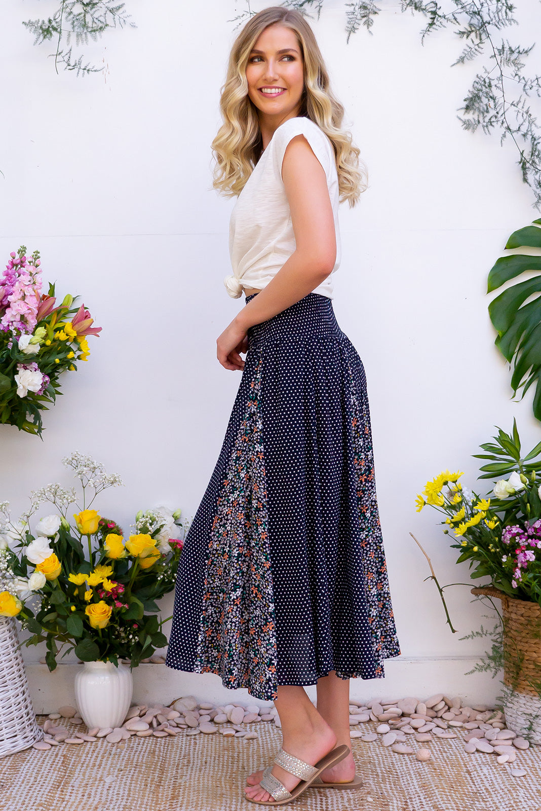 Etosha Spots and Stars Skirt - Features fishtail inserts creating a full circle skirt effect. Made from a soft navy rayon. Includes pockets and a shirred elastic waist.