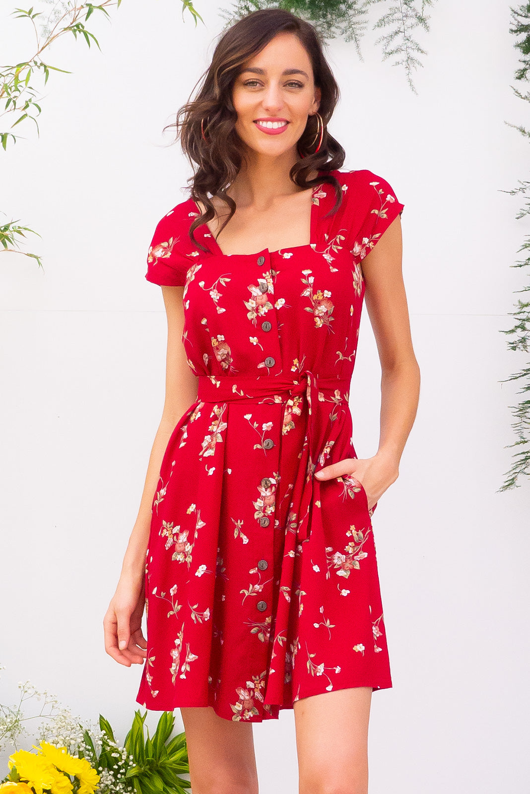 Etta Red Daze Dress with a gathered cap sleeve, full button front and deep side pockets comes with a self coloured belt and is made from a bright red printed woven 100% rayon