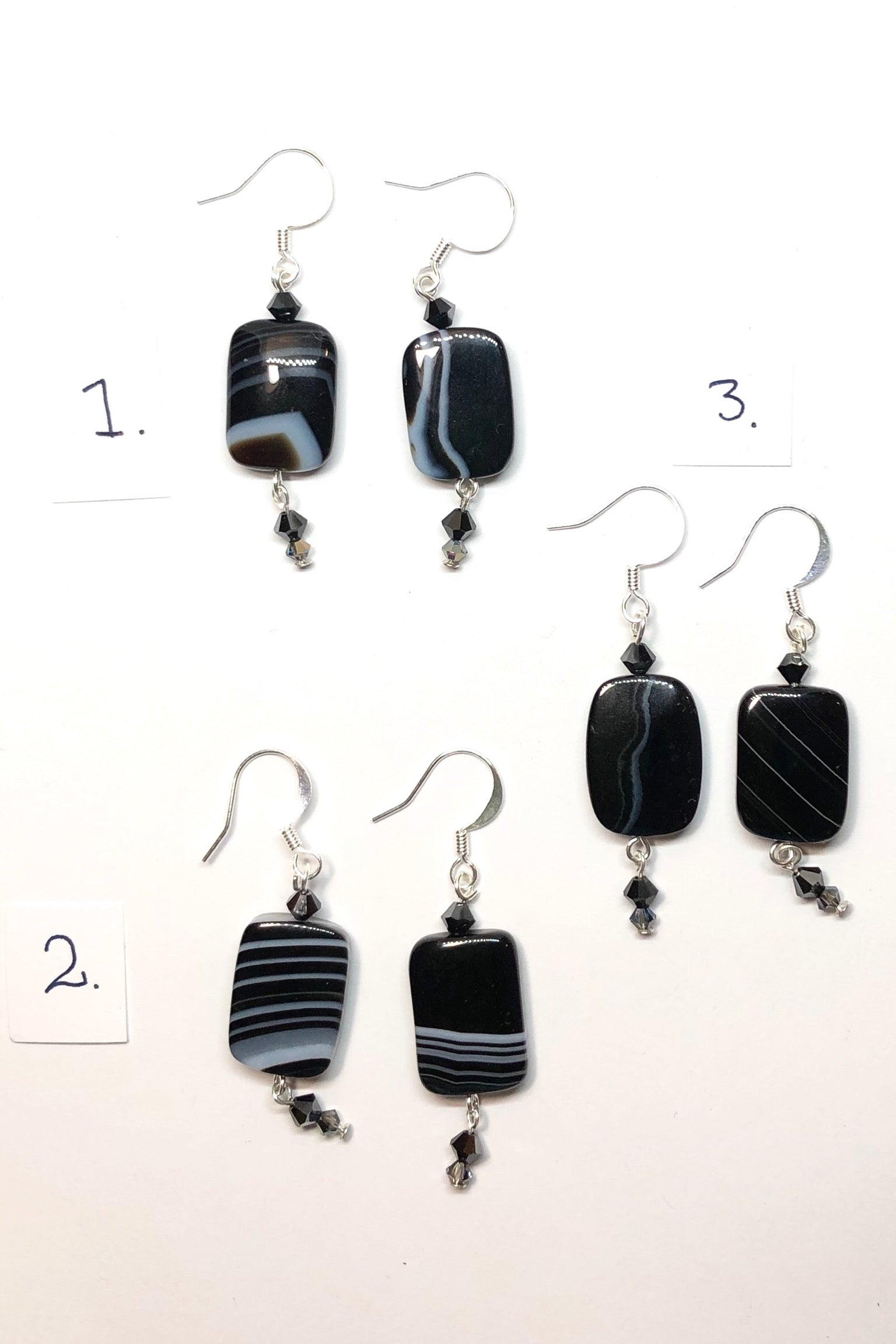 Earrings Rock Banded Black Onyx is a boho luxe style earrings featuring drop style earrings, 925 silver hook earrings and polished black banded onyx shaped stone with a swarovski crystal beads.